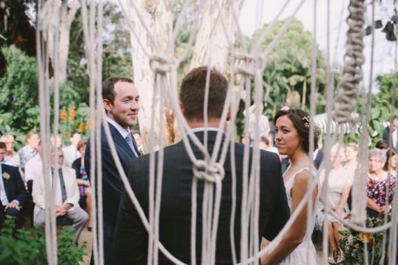 Macramé wedding aisle backdrop | Photography by Lara Hotz