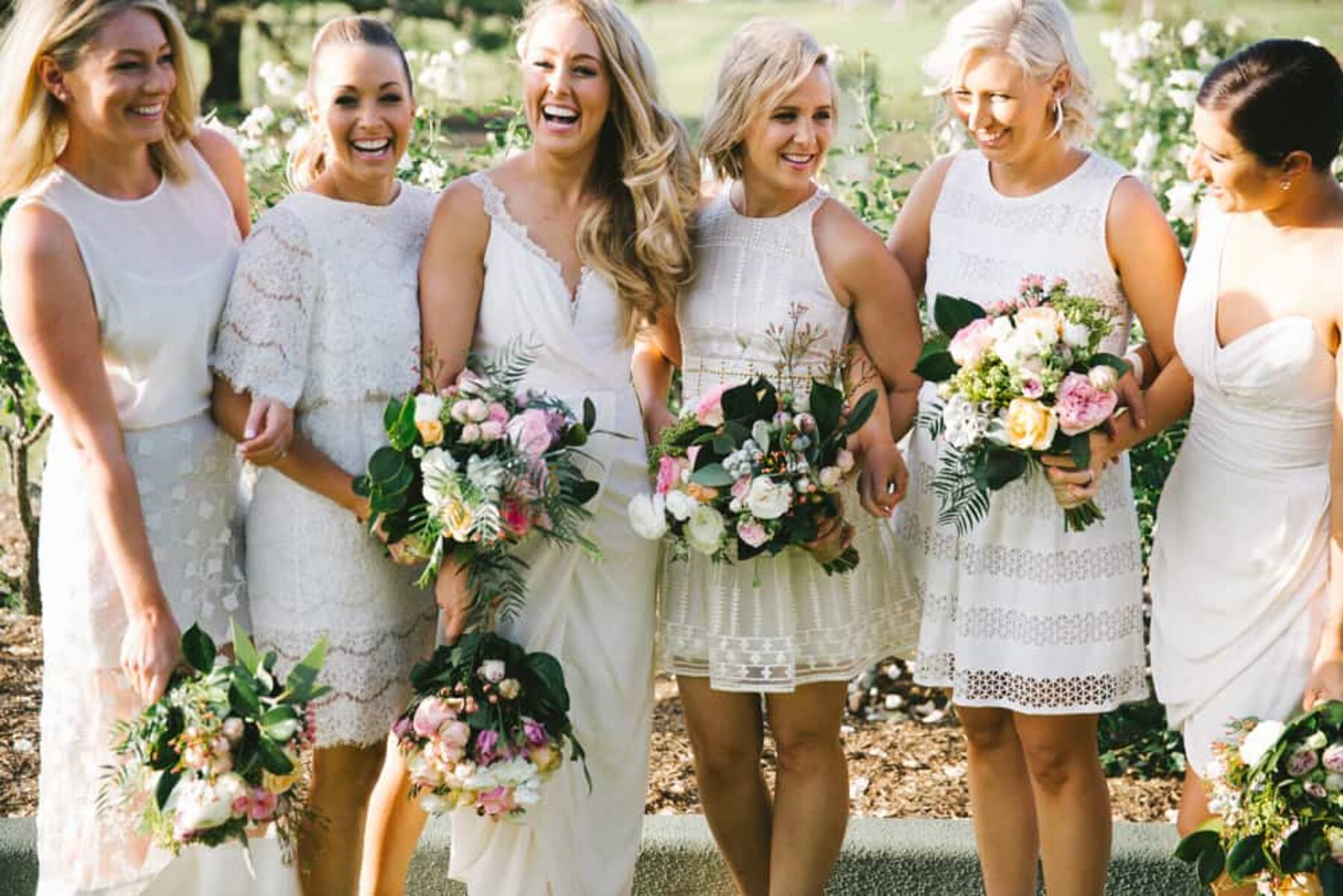 Bridesmaids in different white dresses / Kait Photography