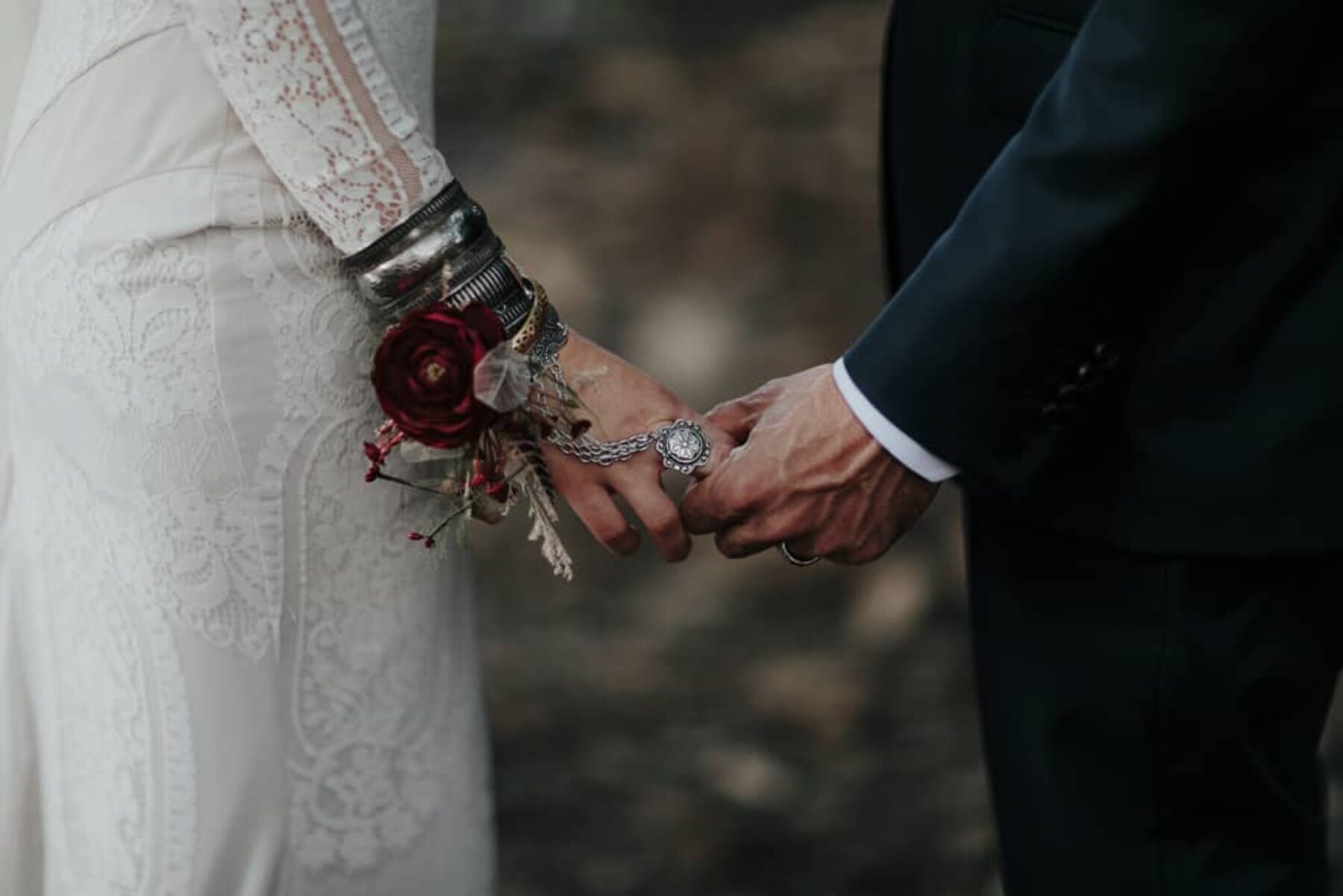 boho bride with silver cuff and ring chain
