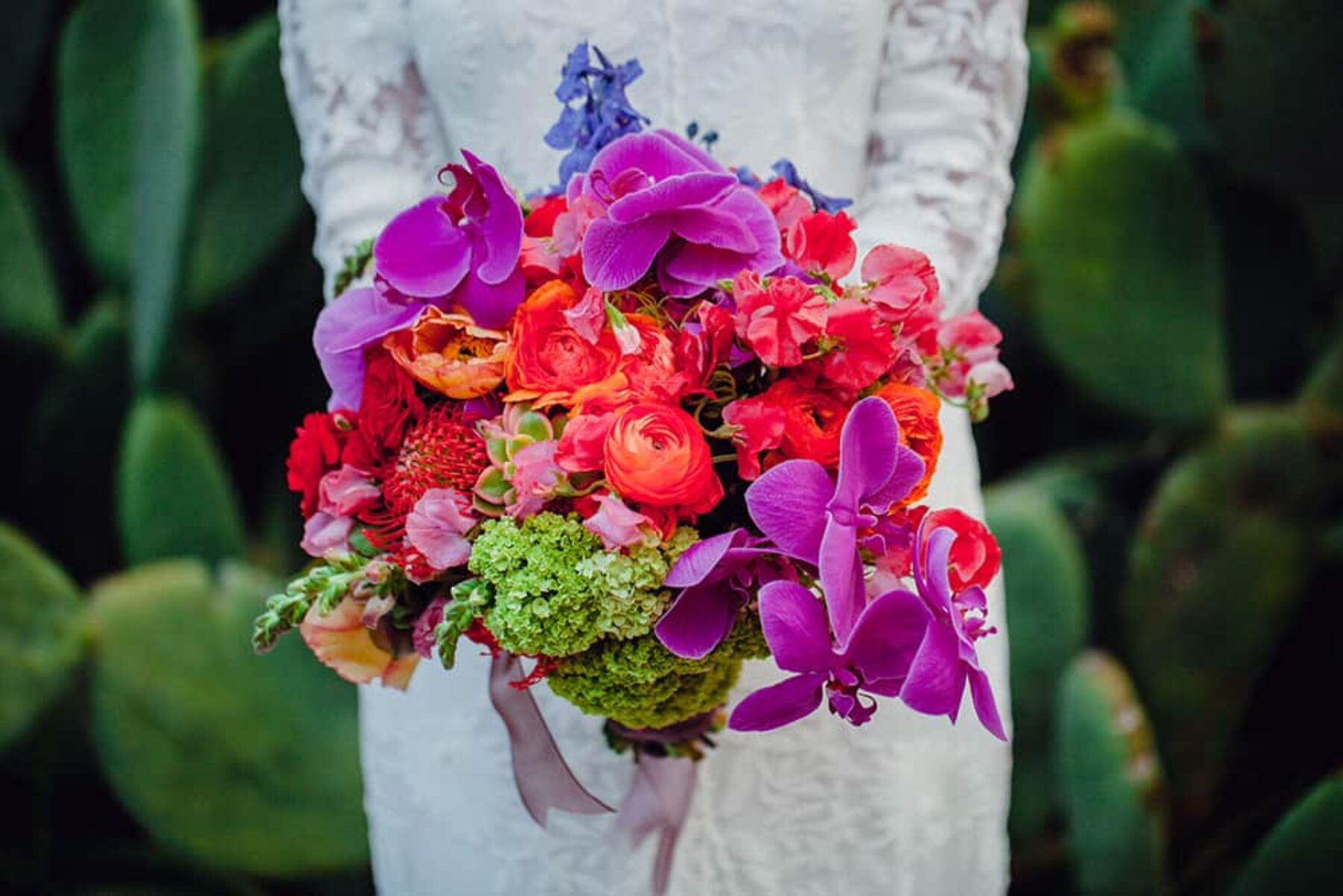 jewel-toned orchid and ranunculus wedding bouquet