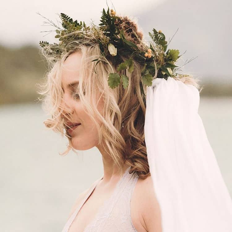 bride in wildflower crown with veil