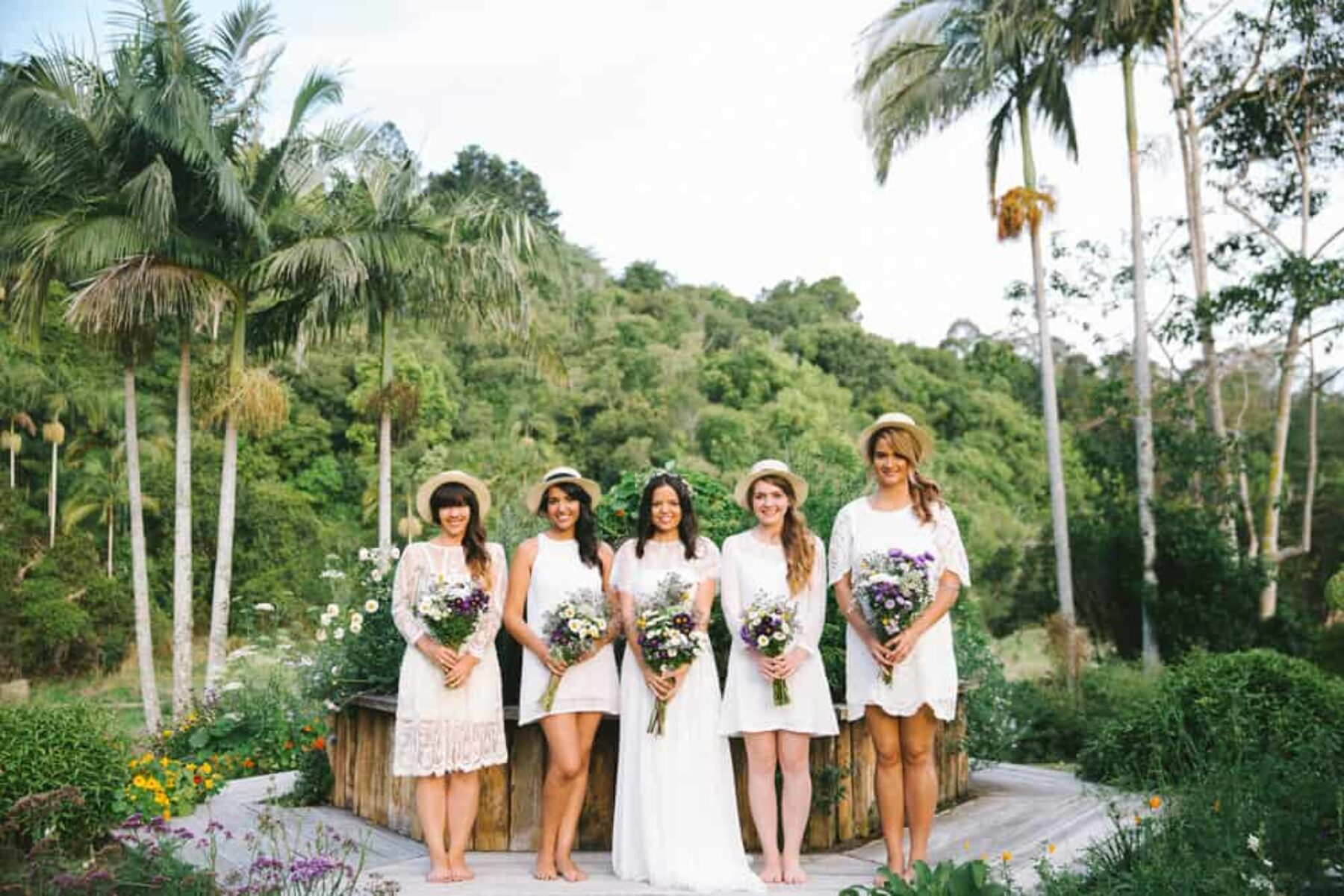 bridesmaids in white dresses and hats