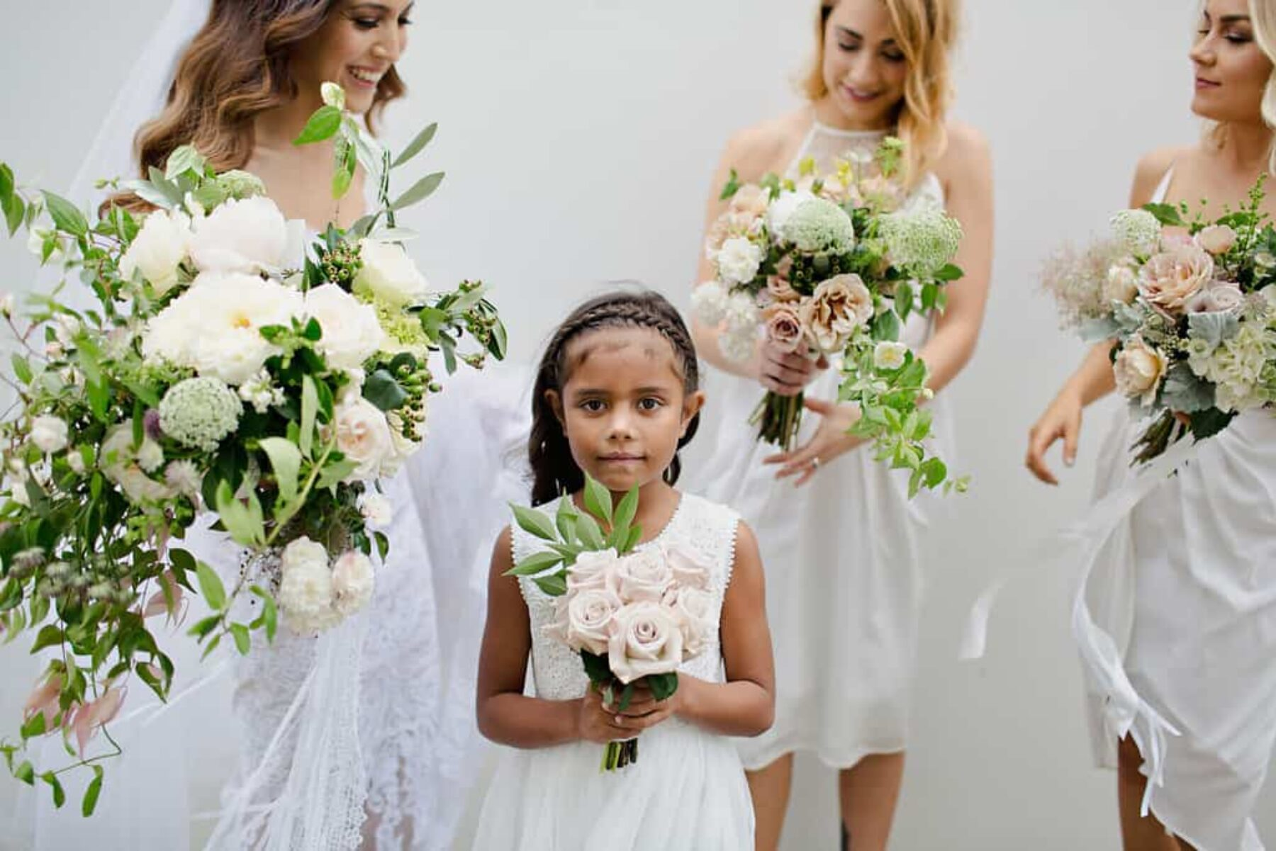 bridesmaids and flower girl in white
