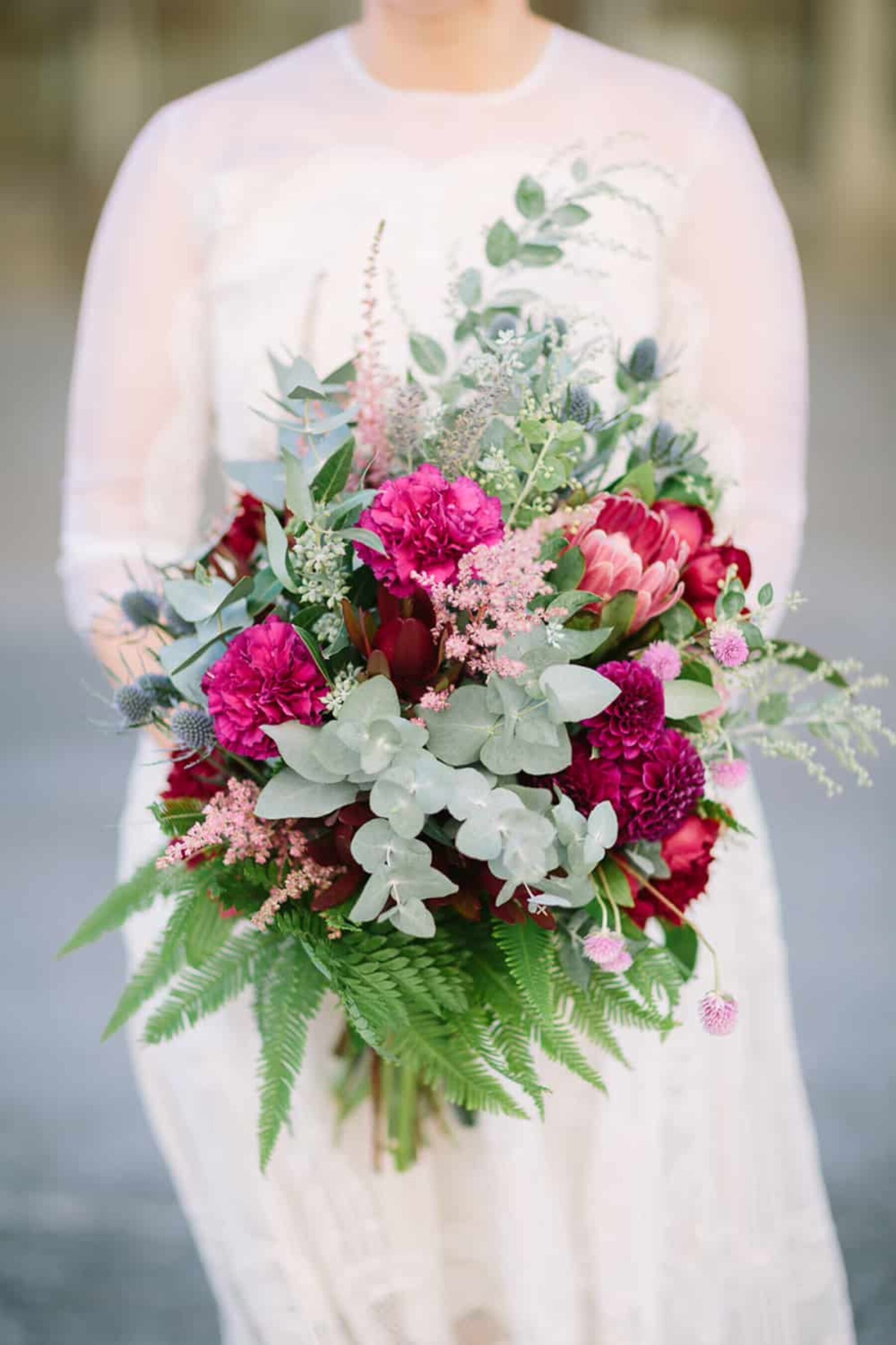 magenta bouquet with native foliage