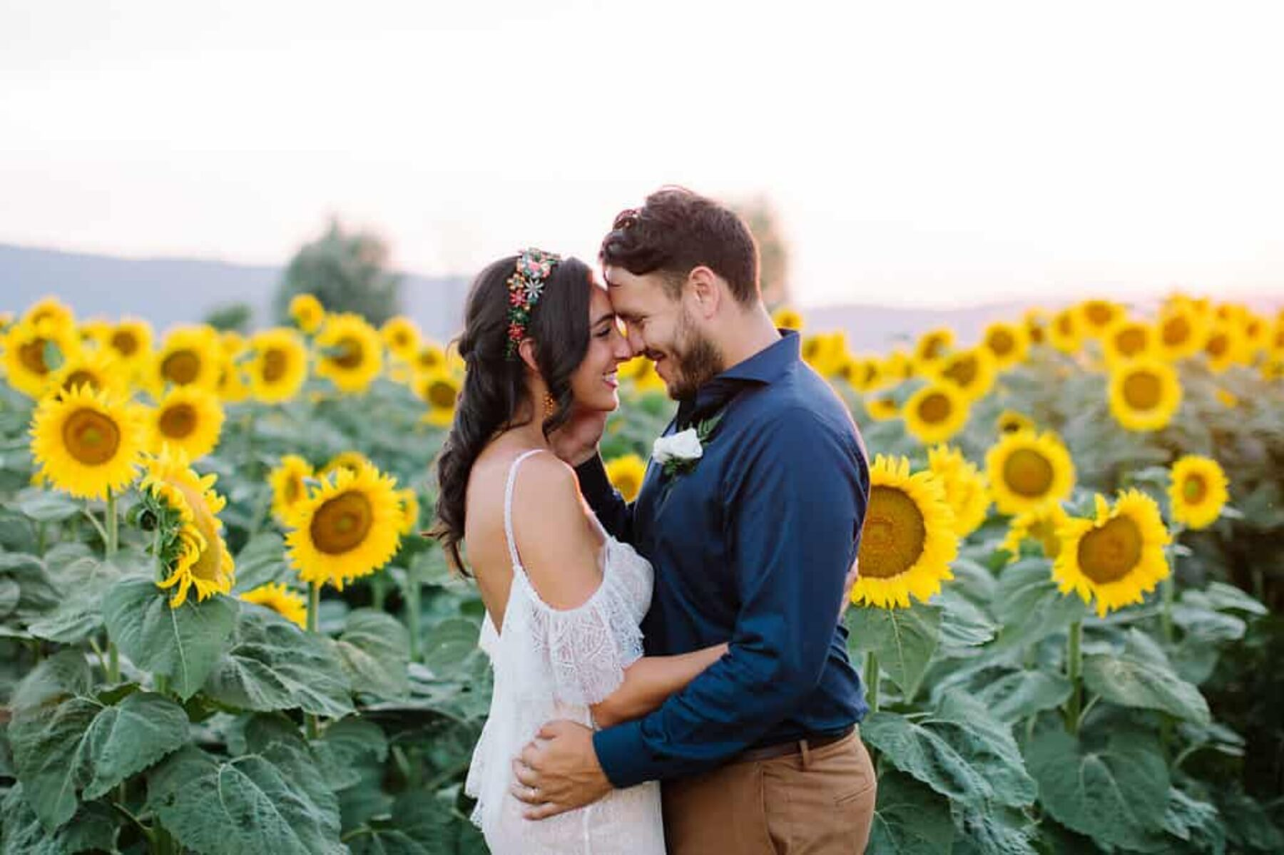 bride and groom in a sea of sunflowers in Tuscany