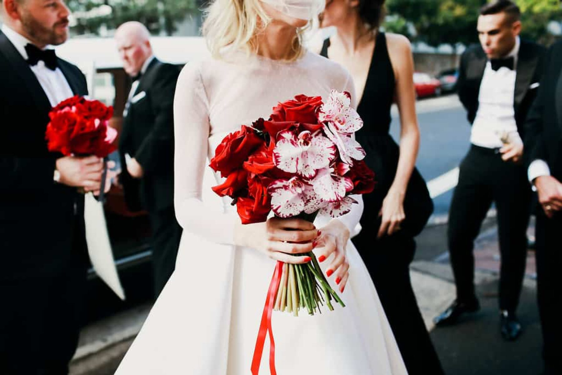 red rose and orchid wedding bouquet
