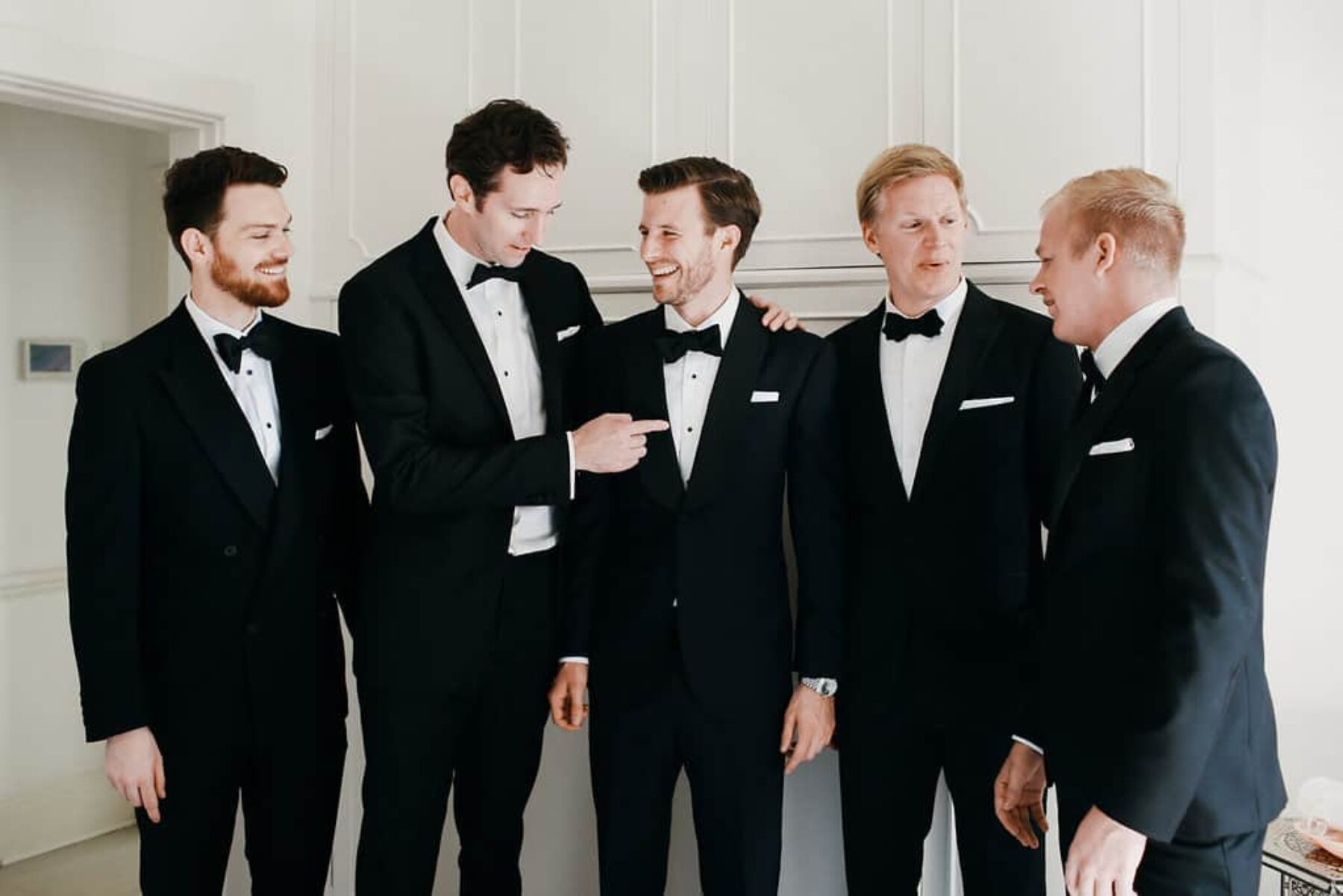 groom and groomsmen in classic tuxes
