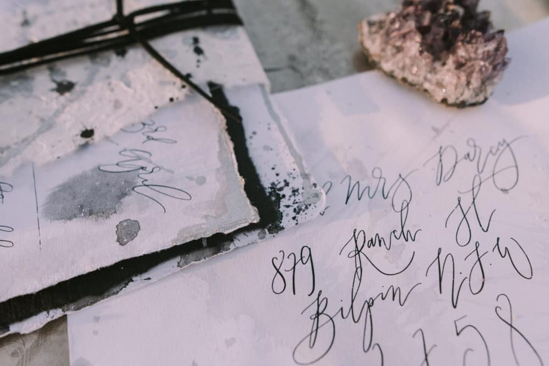 raw paper and calligraphy wedding stationery