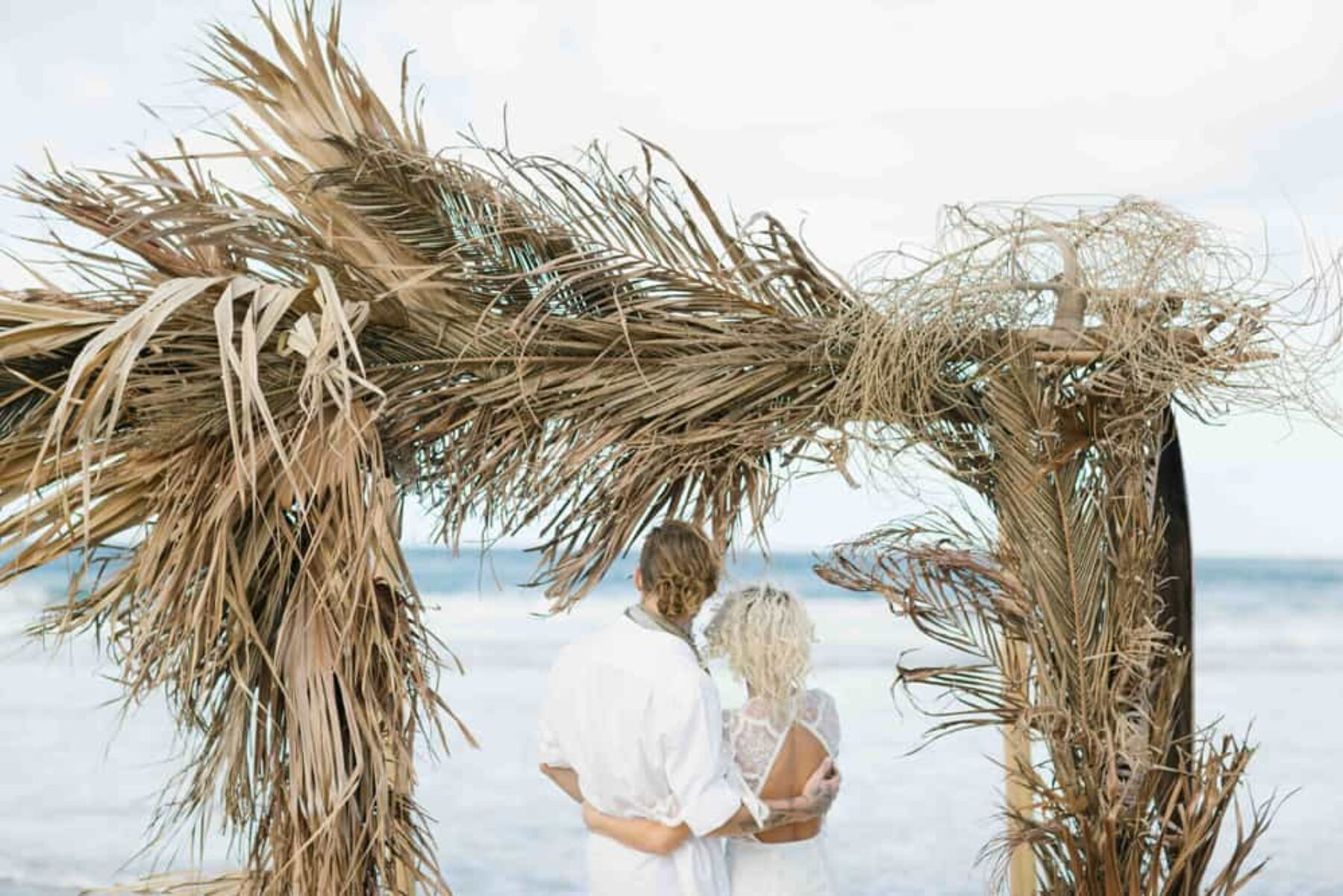 beach wedding arbour of dried palm fronds