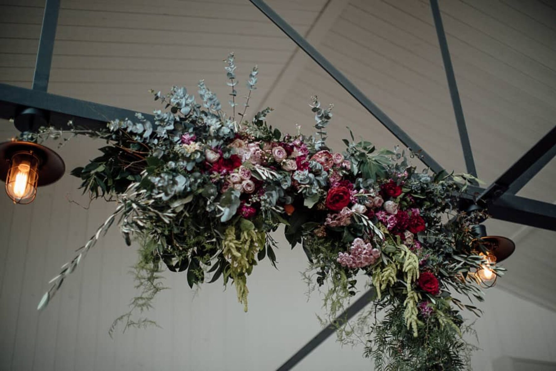 hanging floral installation by Raven and the Rose