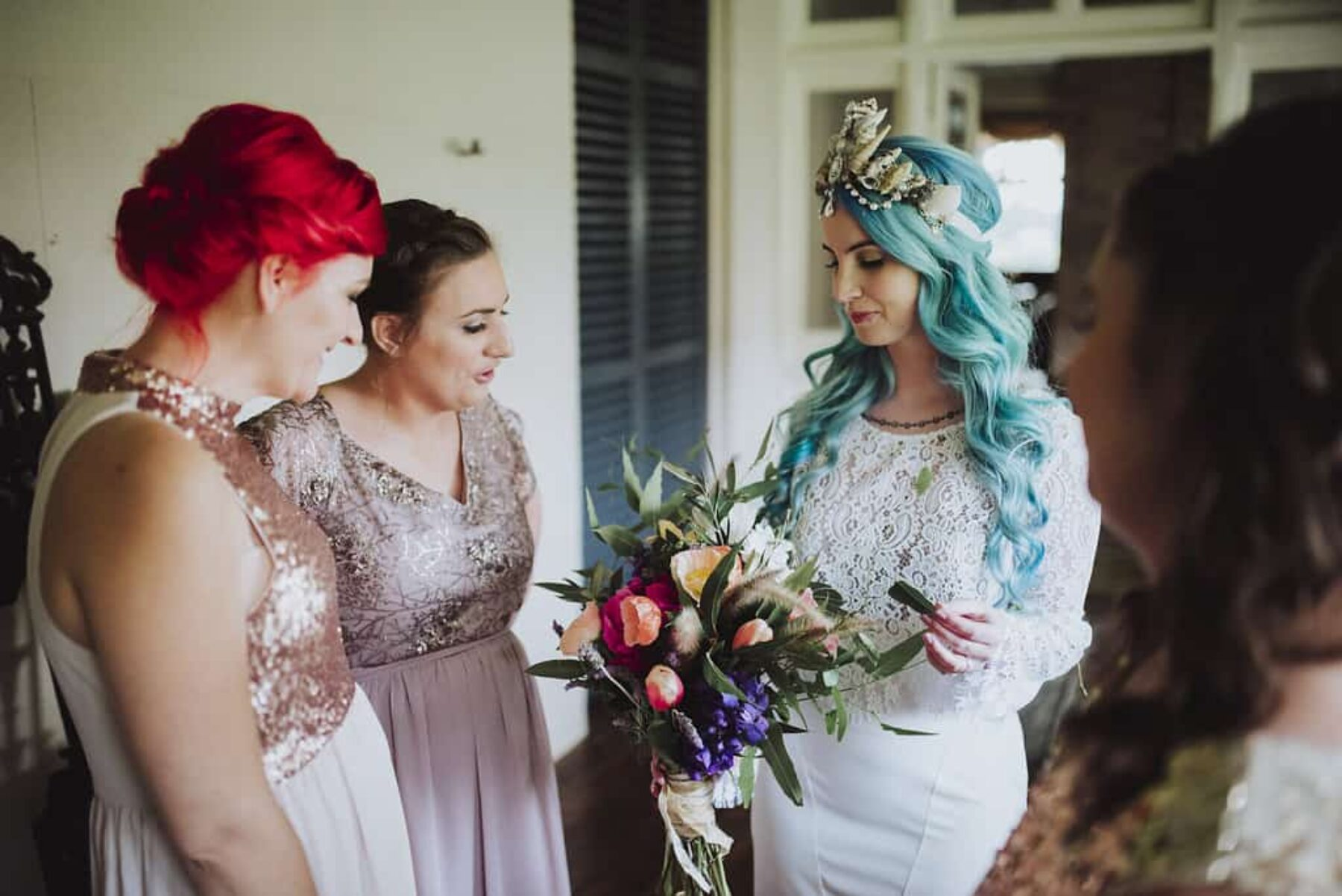 blue haired bride and bridesmaids