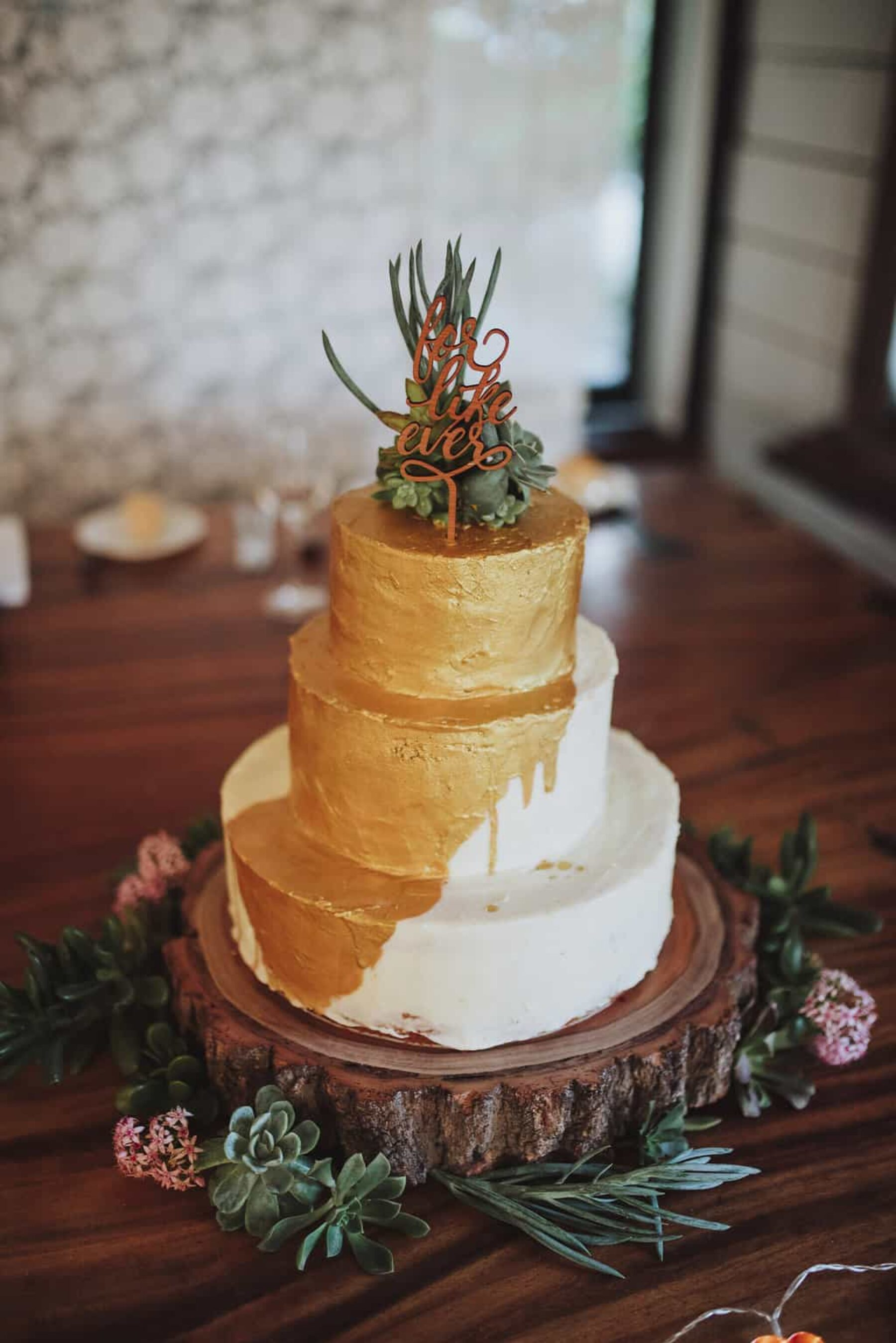 gold wedding cake with succulents