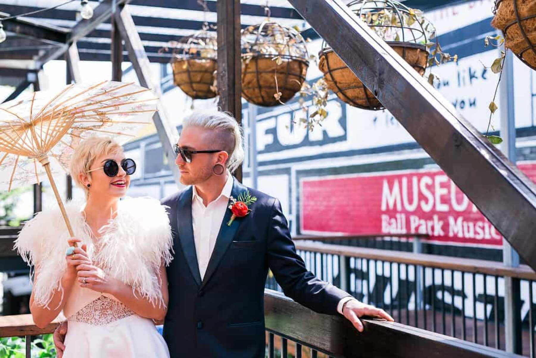 cool bride and groom with parasol