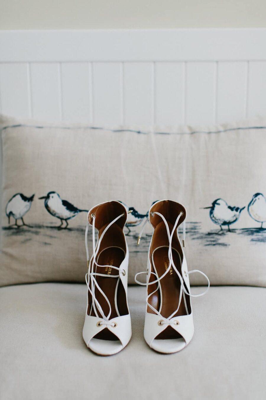 white Aquazzura lace-up heels