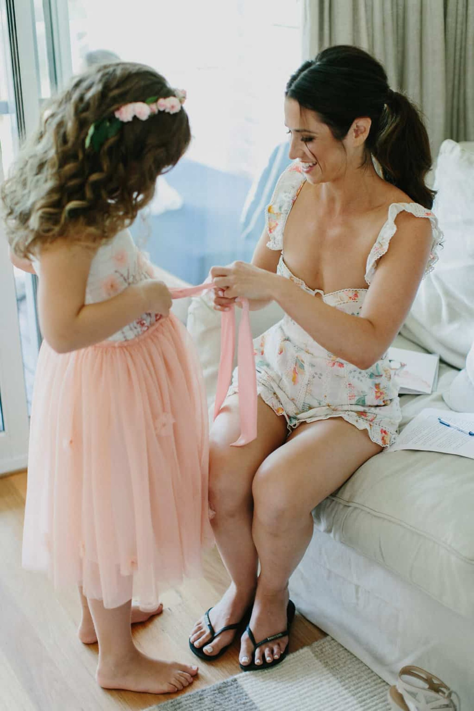 bride and flower girl getting ready