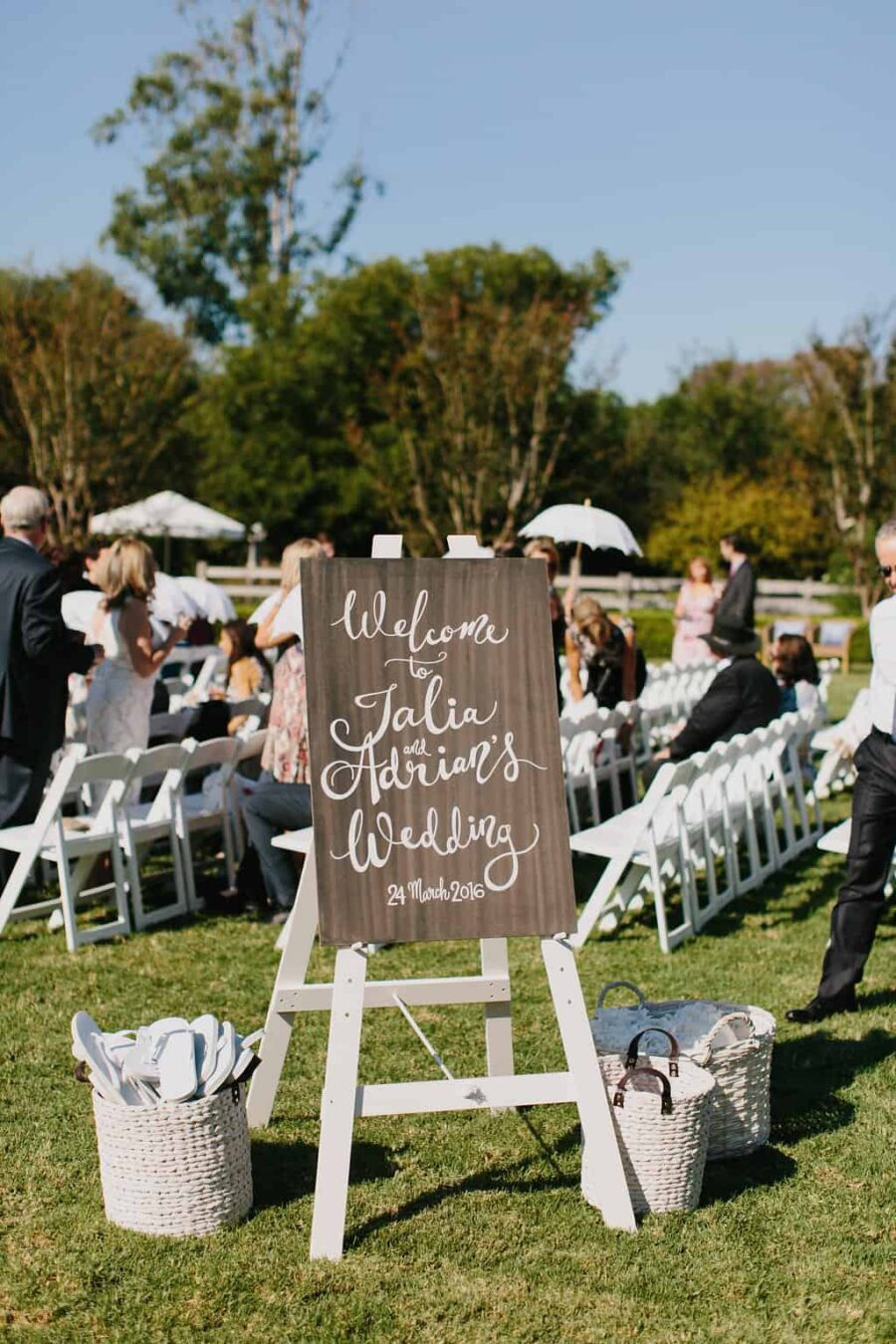 timber hand-painted wedding welcome sign