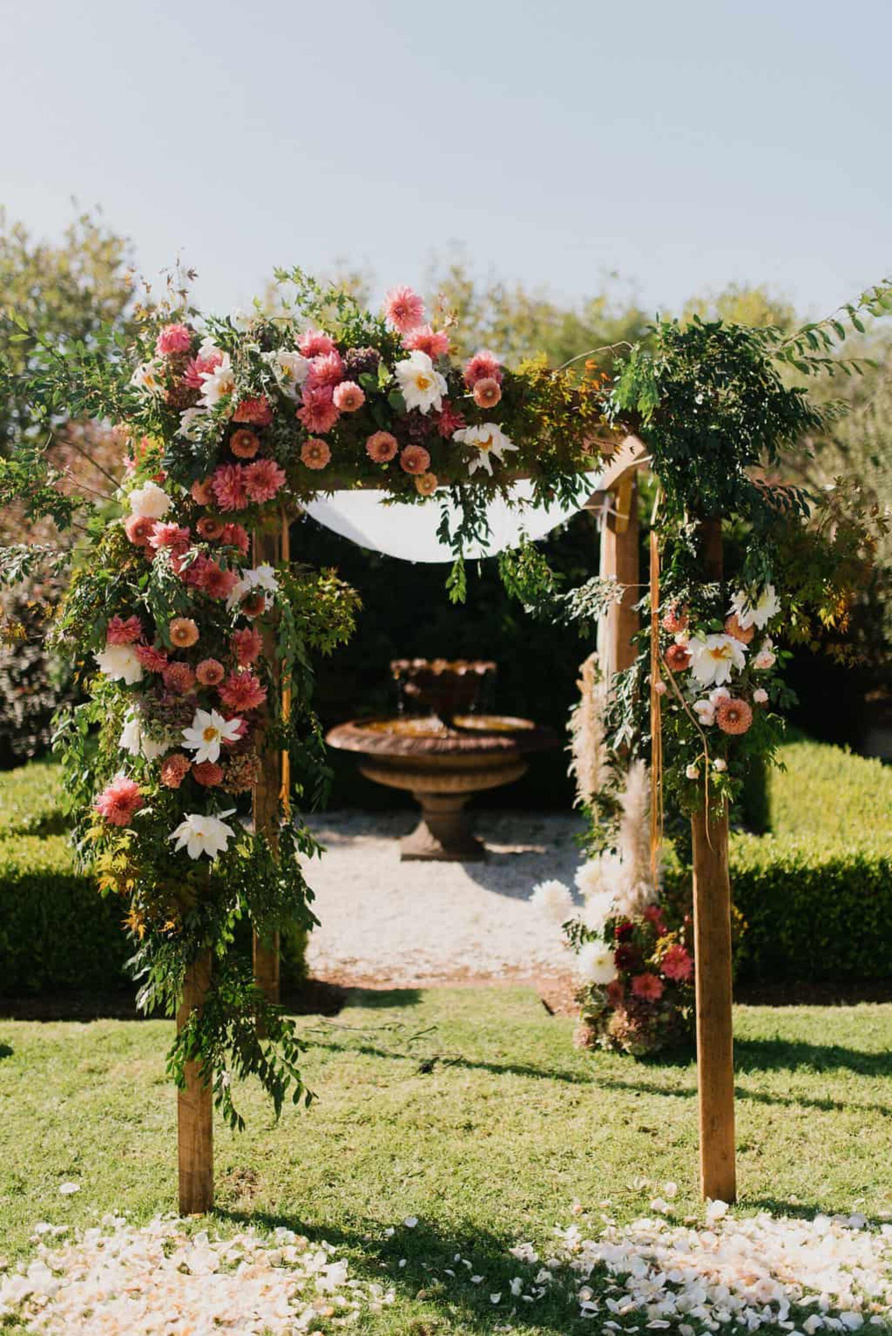 dahlia-laden wedding arch