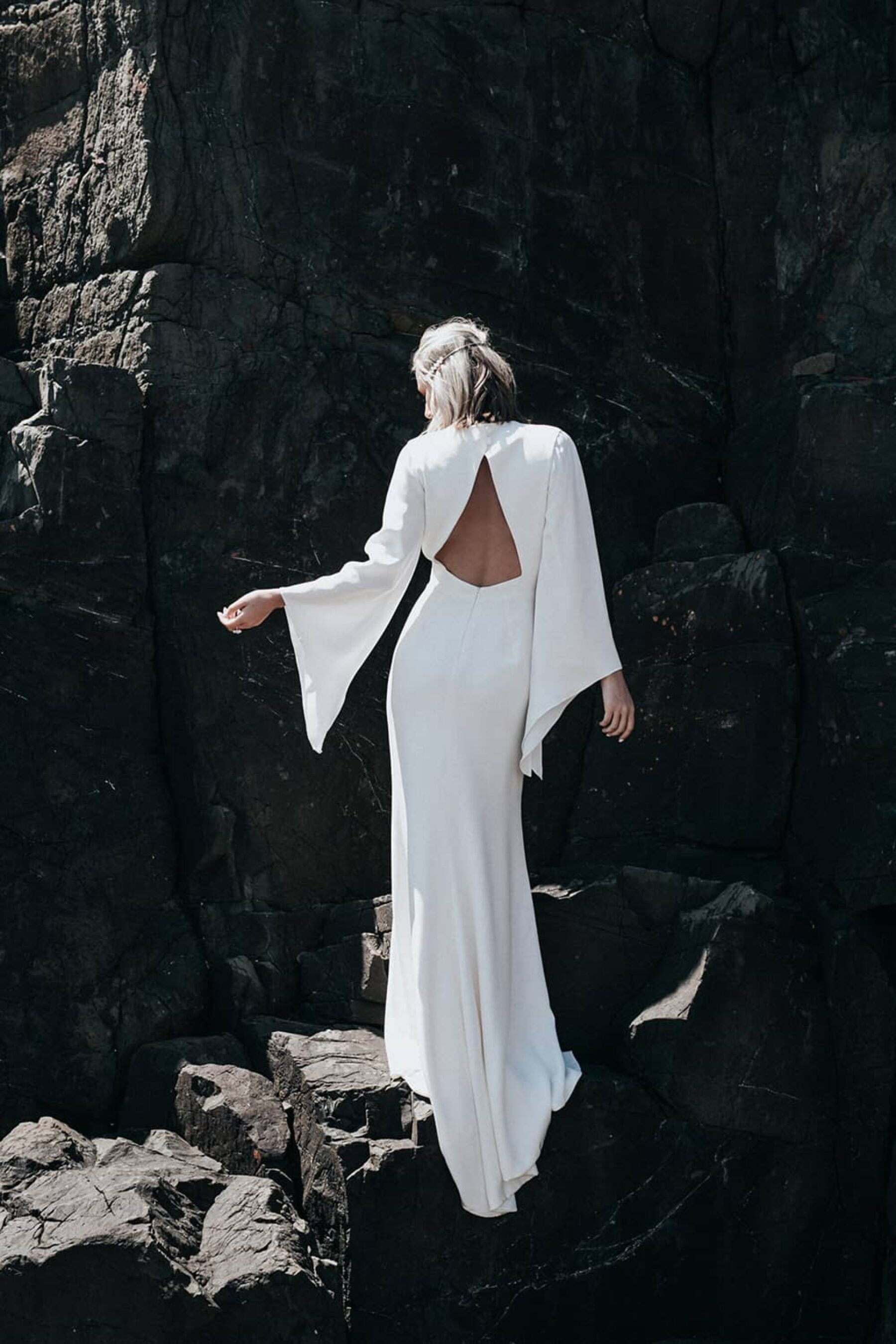 modern backless wedding dress with bell sleeves