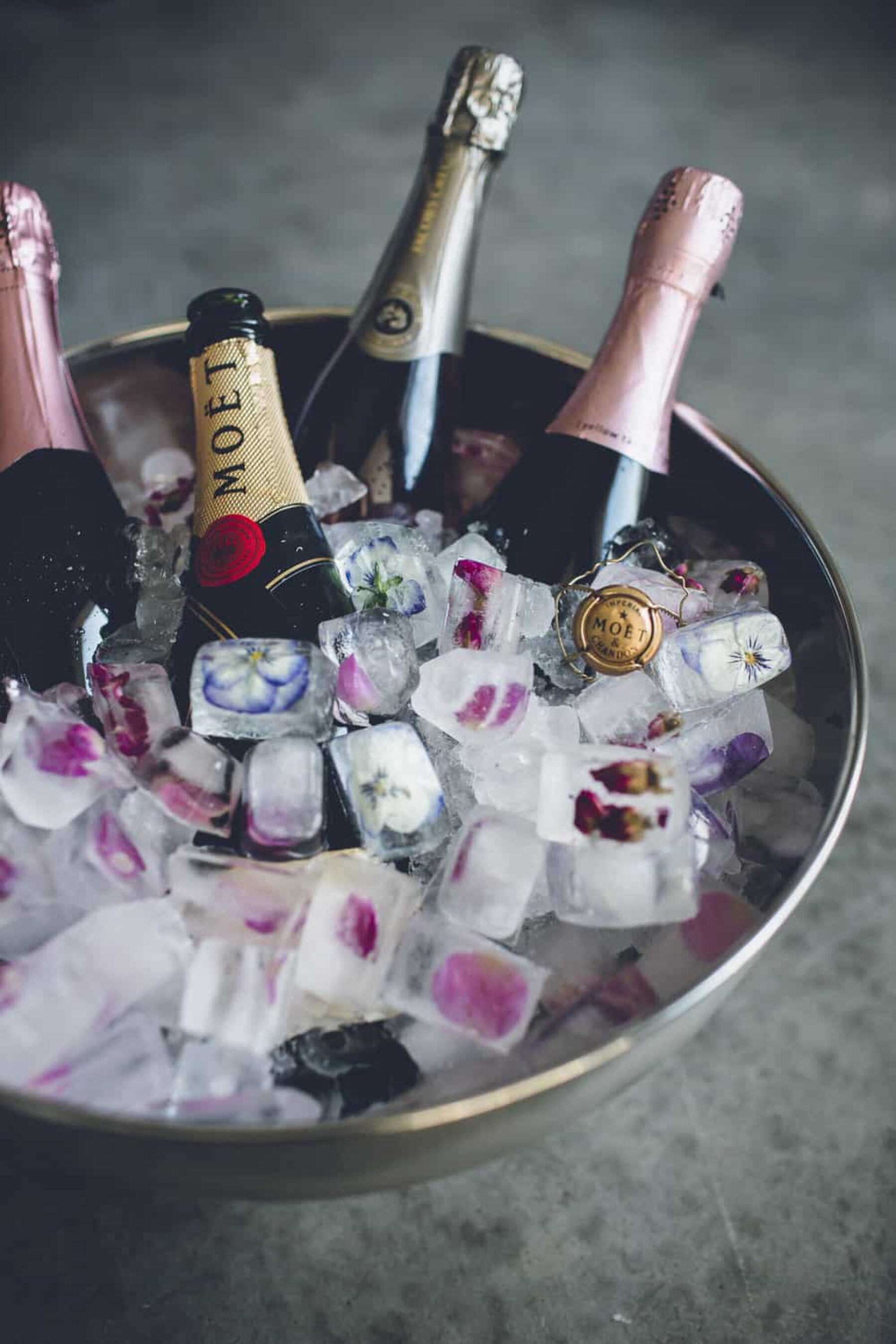 champagne ice bucket with frozen flowers