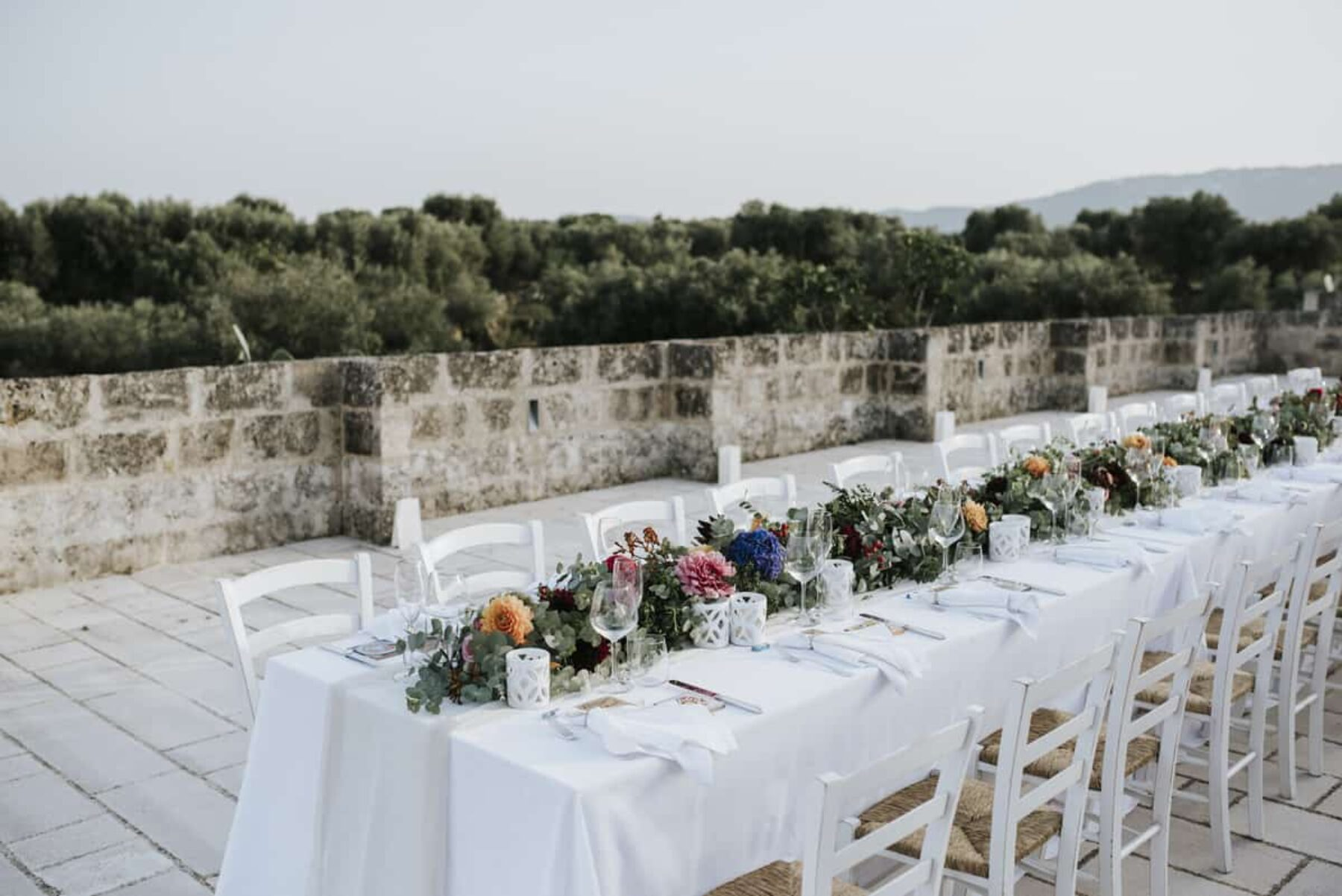 alfresco Italian tablescape with floral table runner