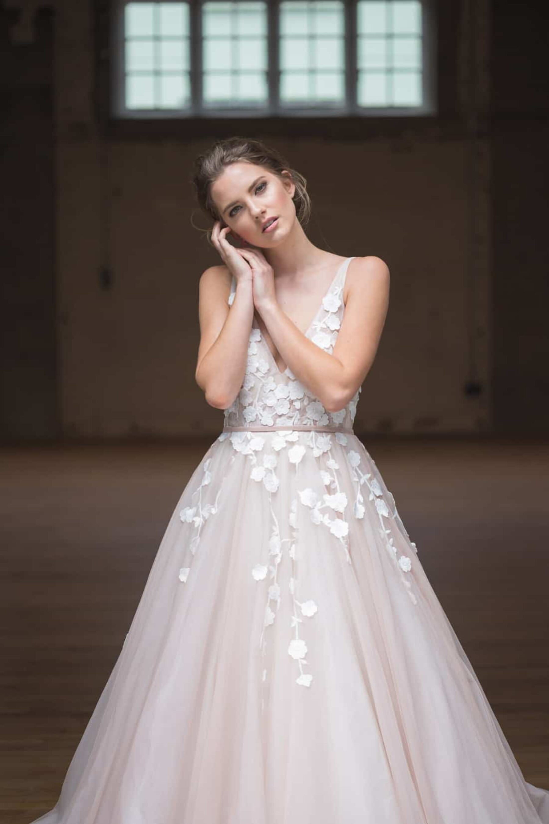blush tulle wedding dress with floral applique