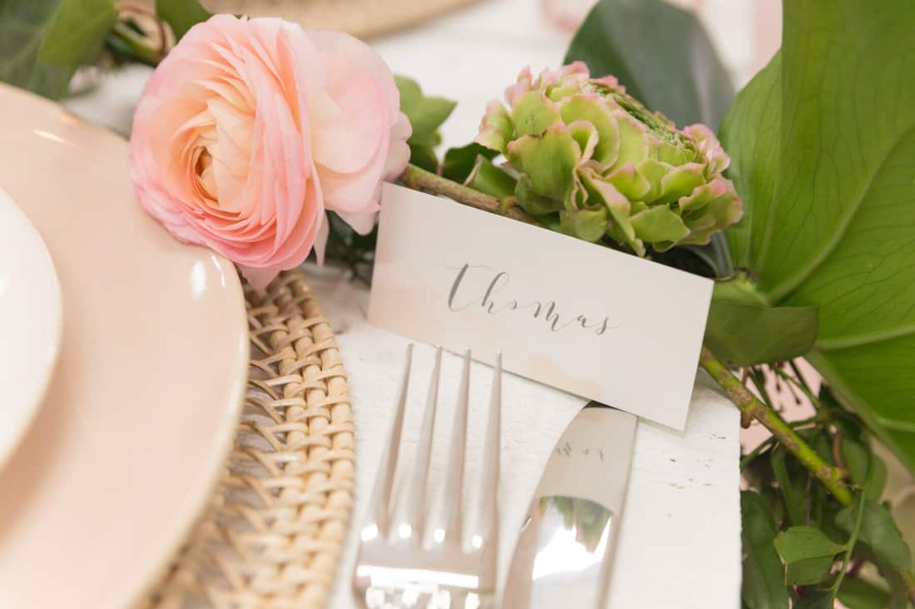 blush tablescape with tropical greenery