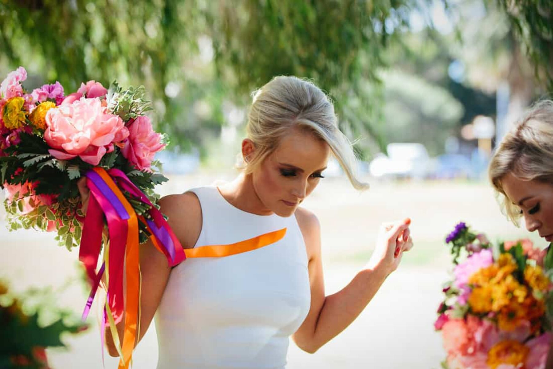 vibrant bouquet with coral peonies and colourful ribbons