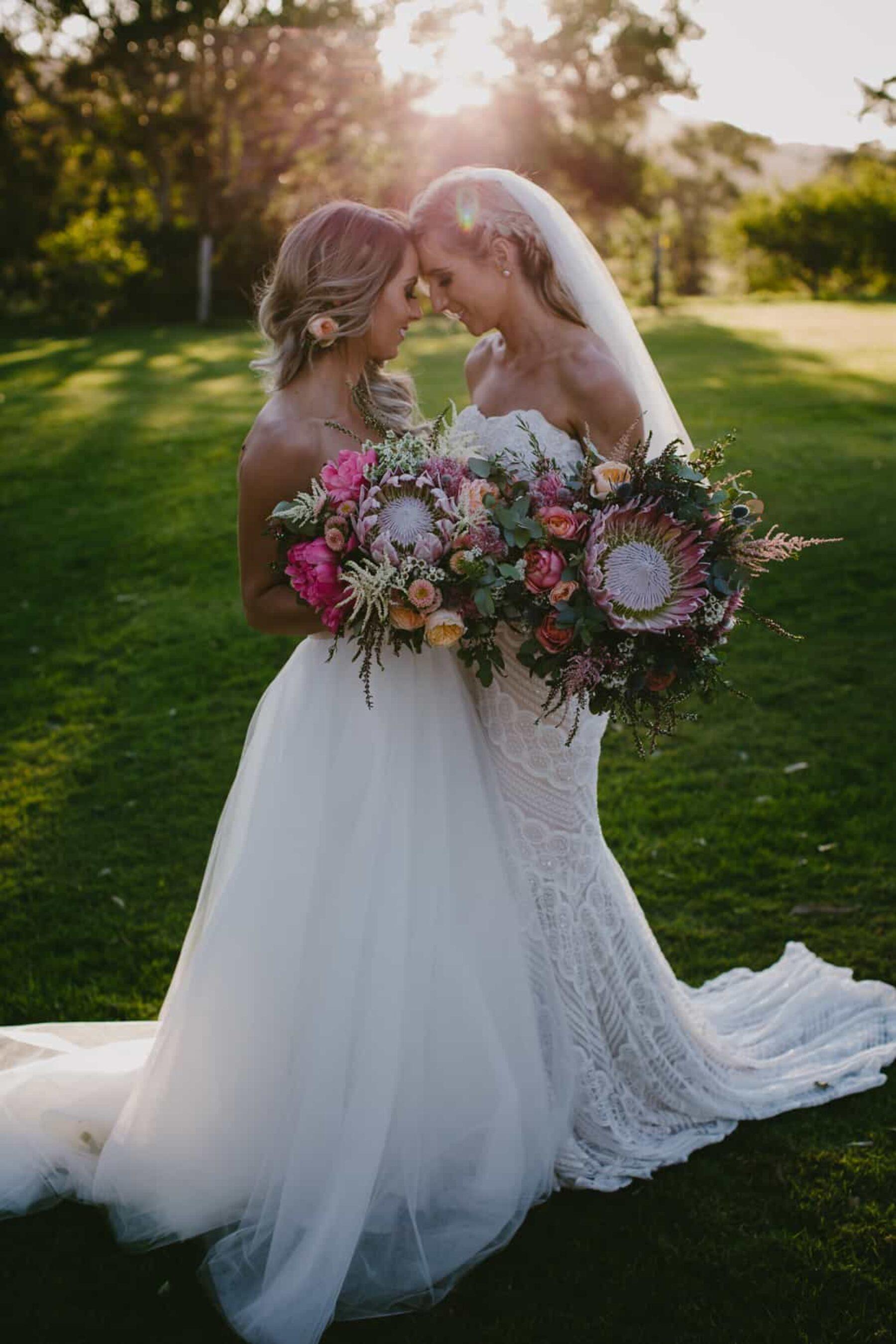 gorgeous brides with protea bouquets