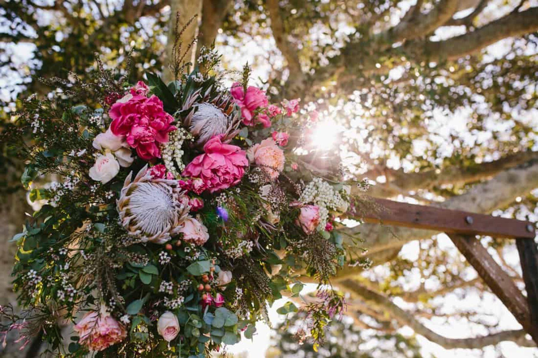 timber floral wedding arbour