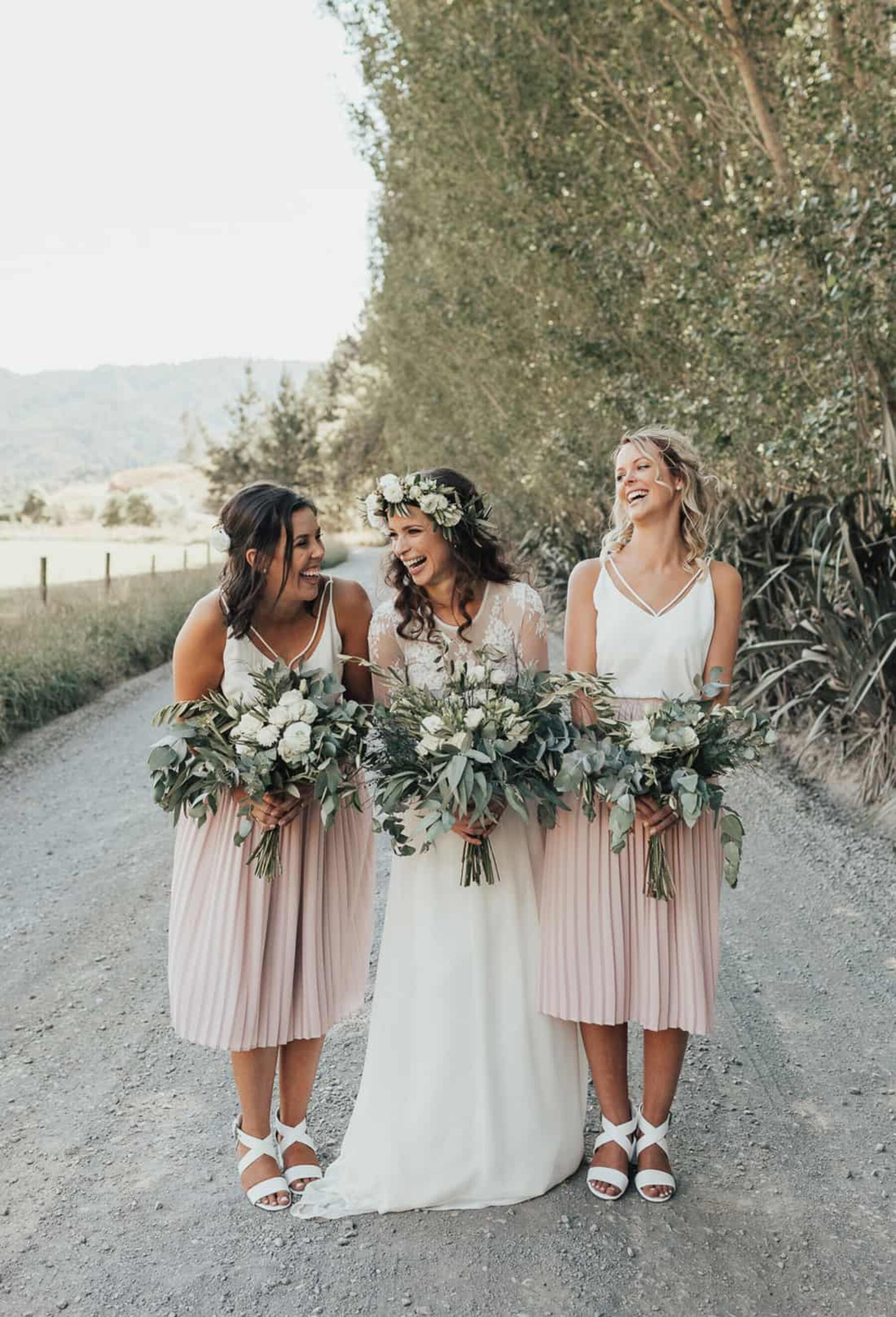 boho bride and bridesmaids with green and white bouquets