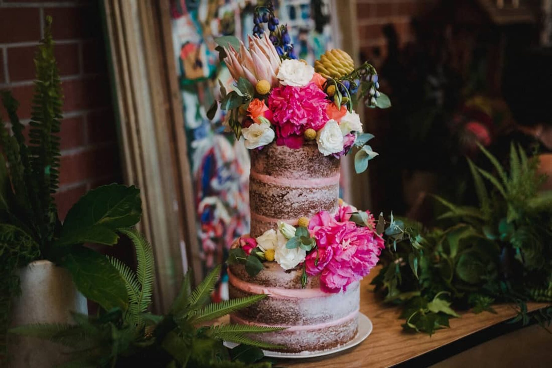 vegan pink wedding cake with gorgeous fresh flowers