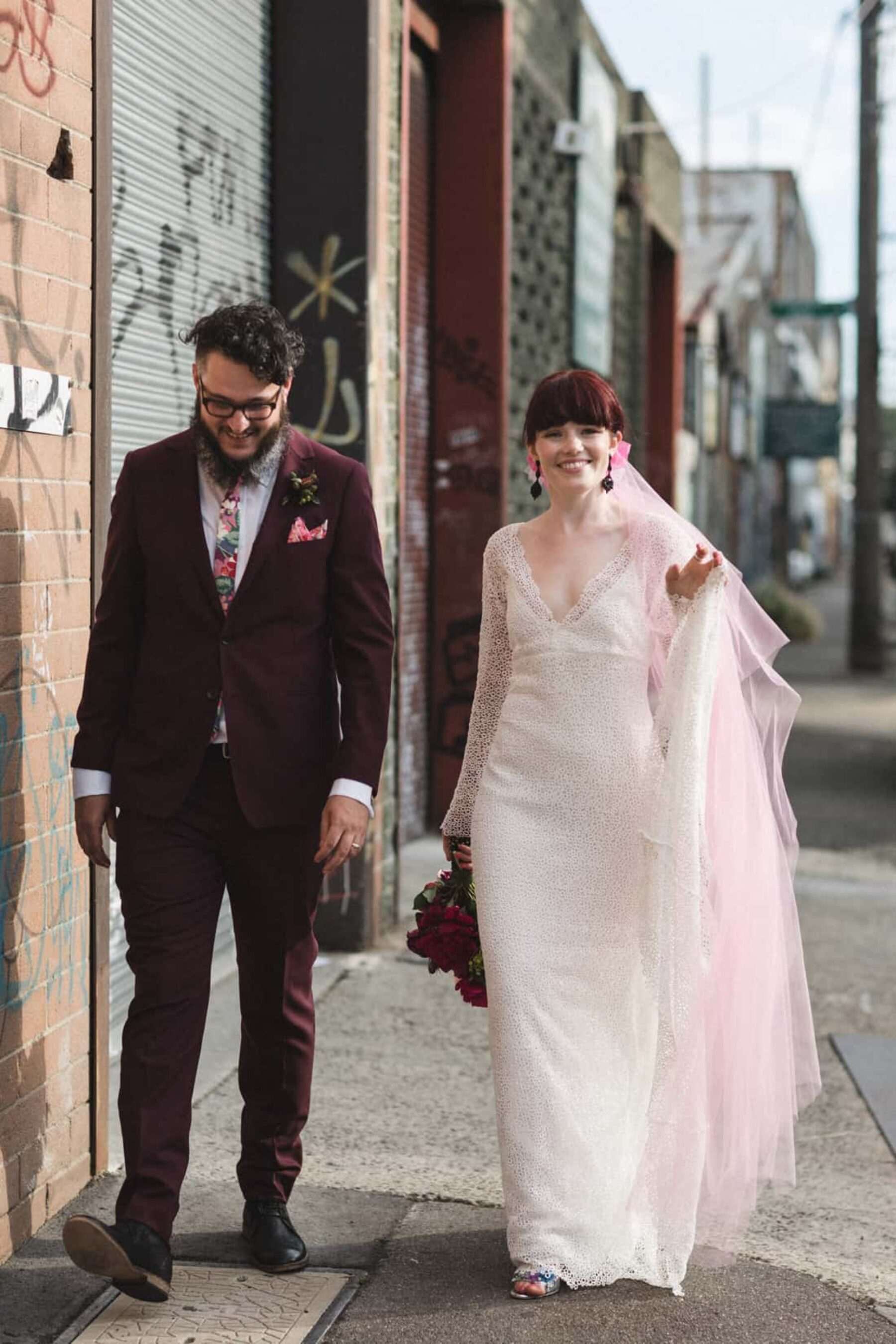 bearded groom and bride with pink tulle veil