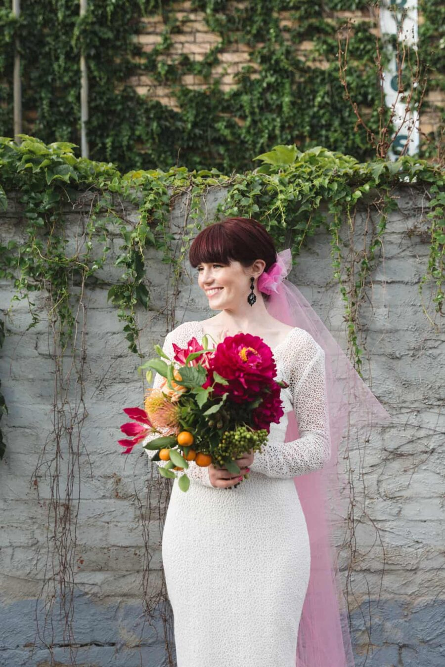 bride with pink veil and bouquet