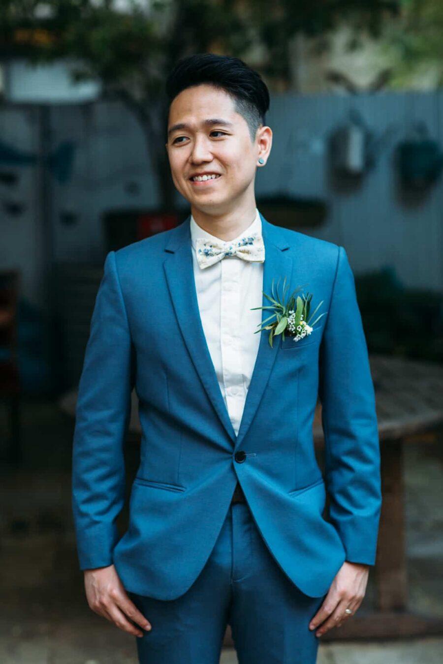 Fremantle weddgroom in cobalt blue suit with floral bow tie