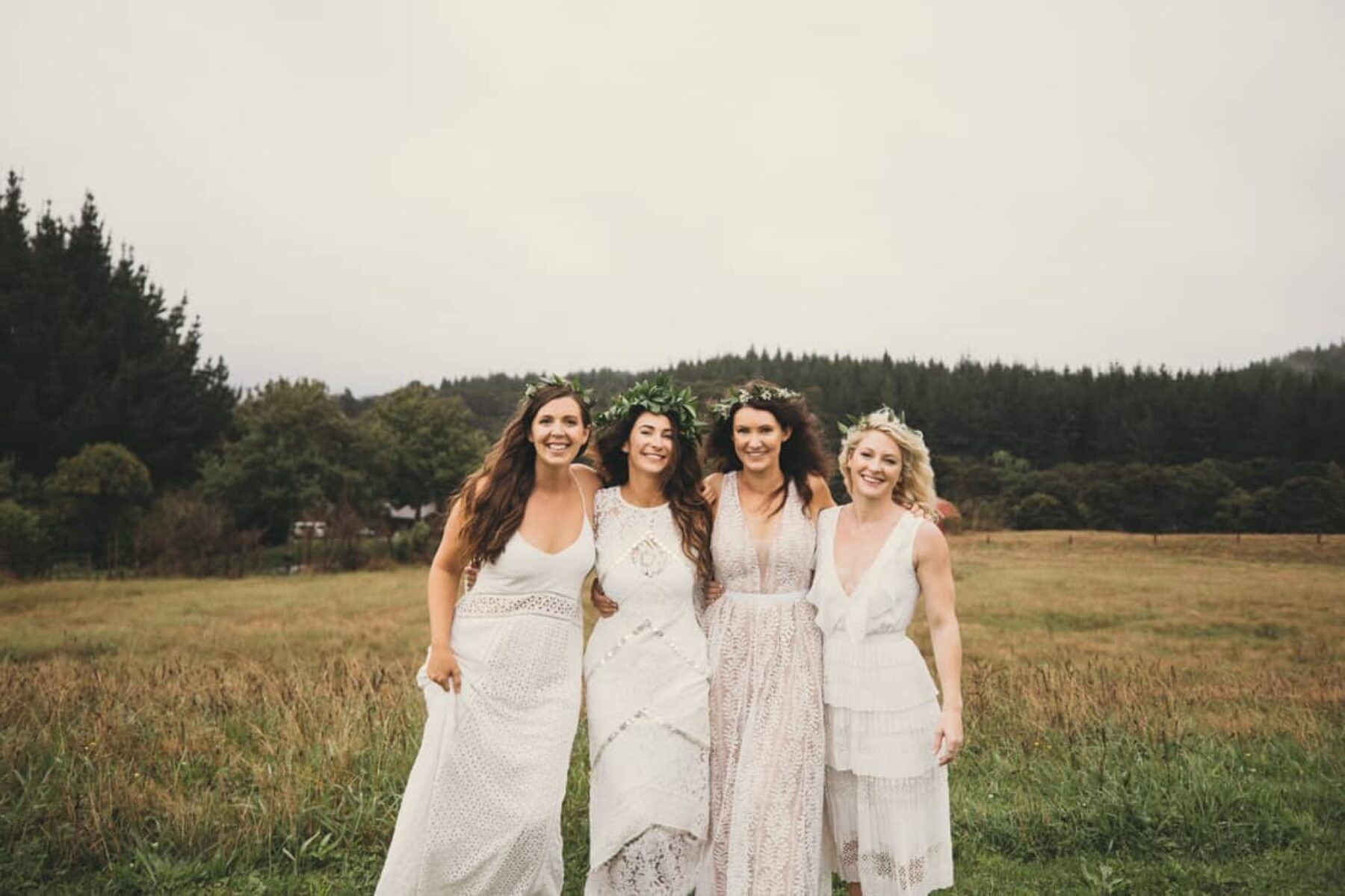 boho bridesmaids in mixed white dresses