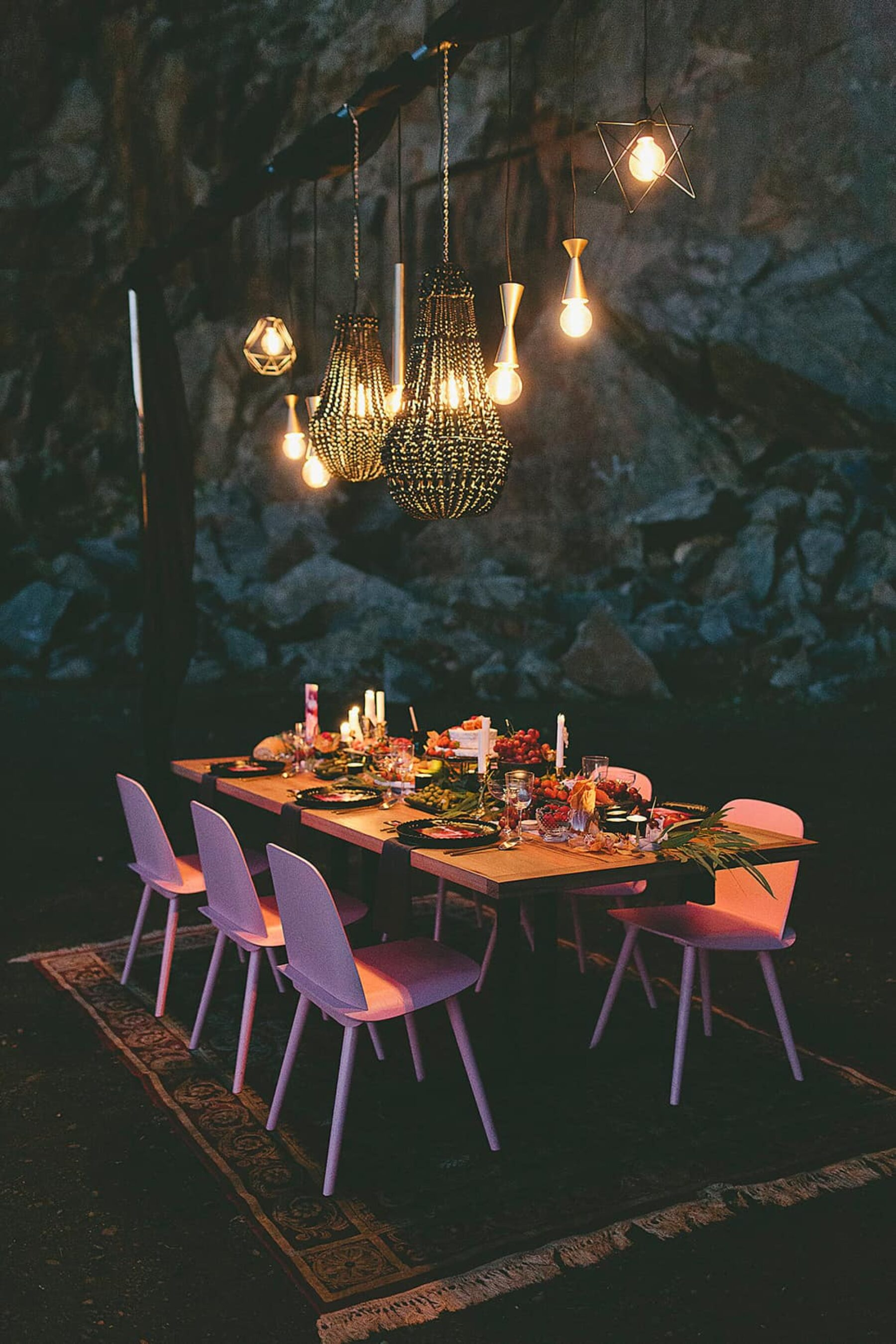 outdoor tablescape with hanging lights