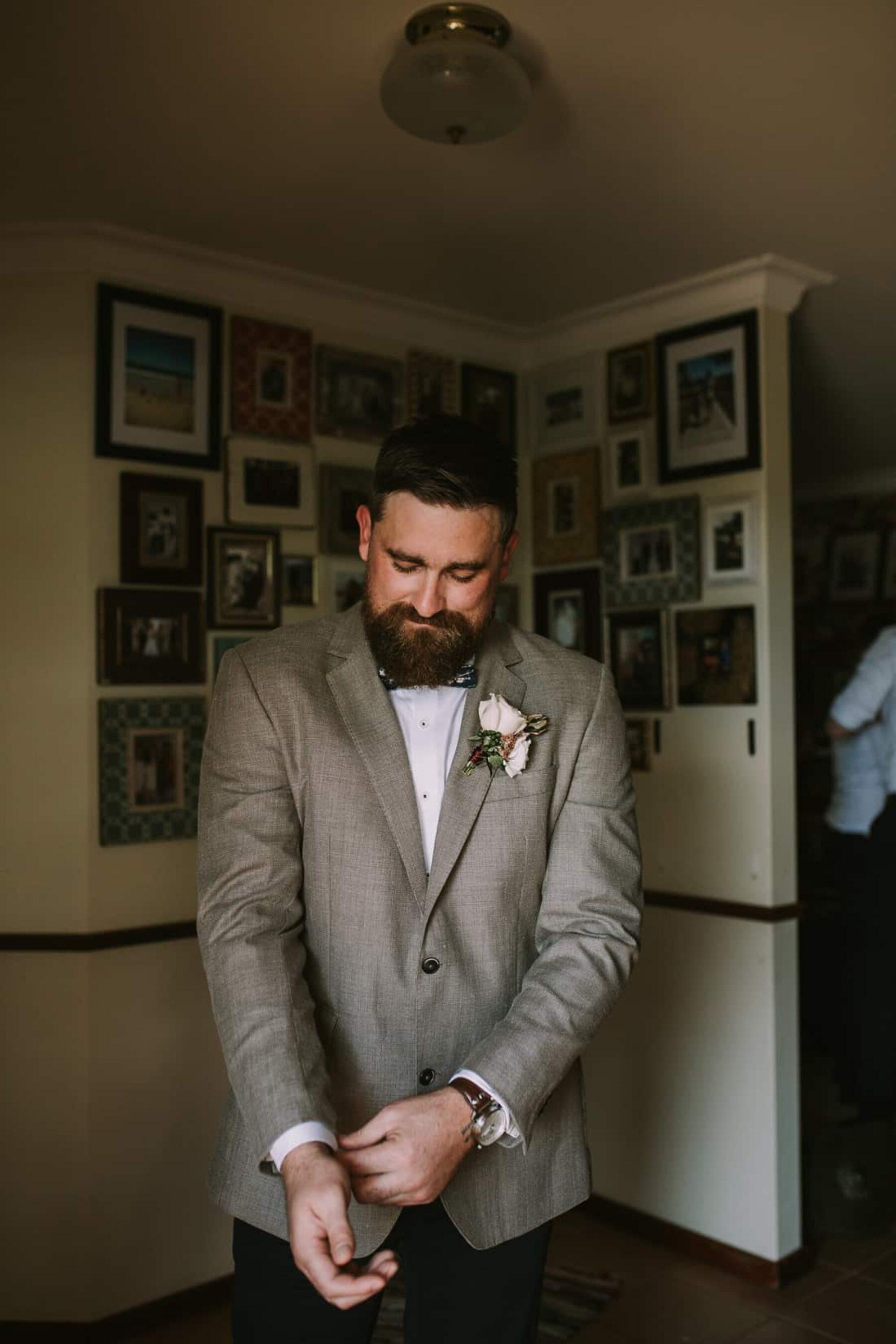 bearded groom in grey jacket