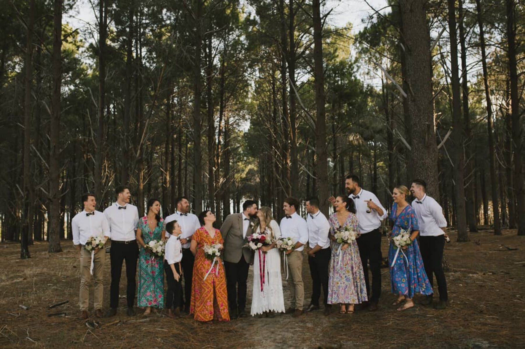 relaxed bridal party with mixed floral print bridesmaid dresses