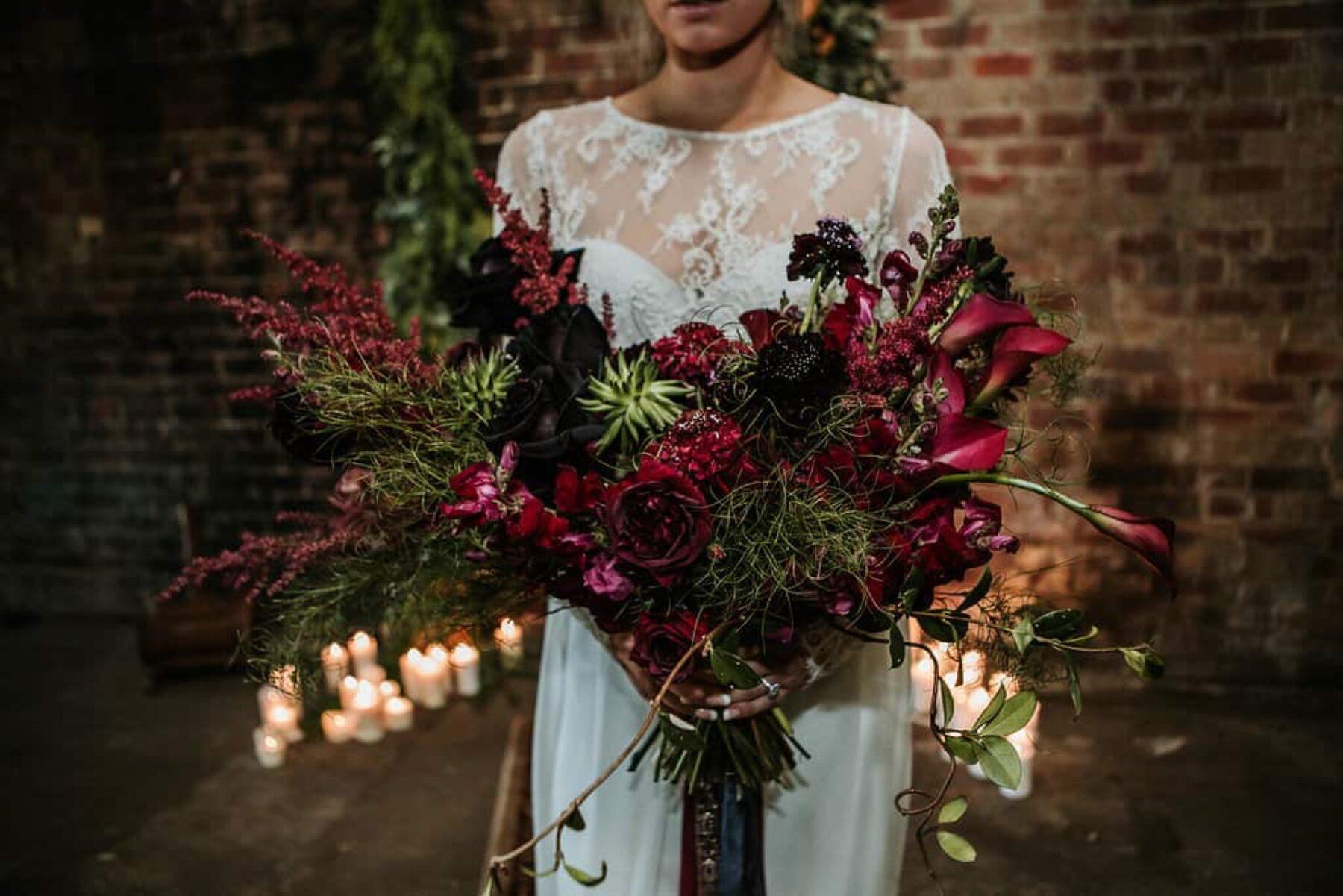 wild bridal bouquet in deep plum tones