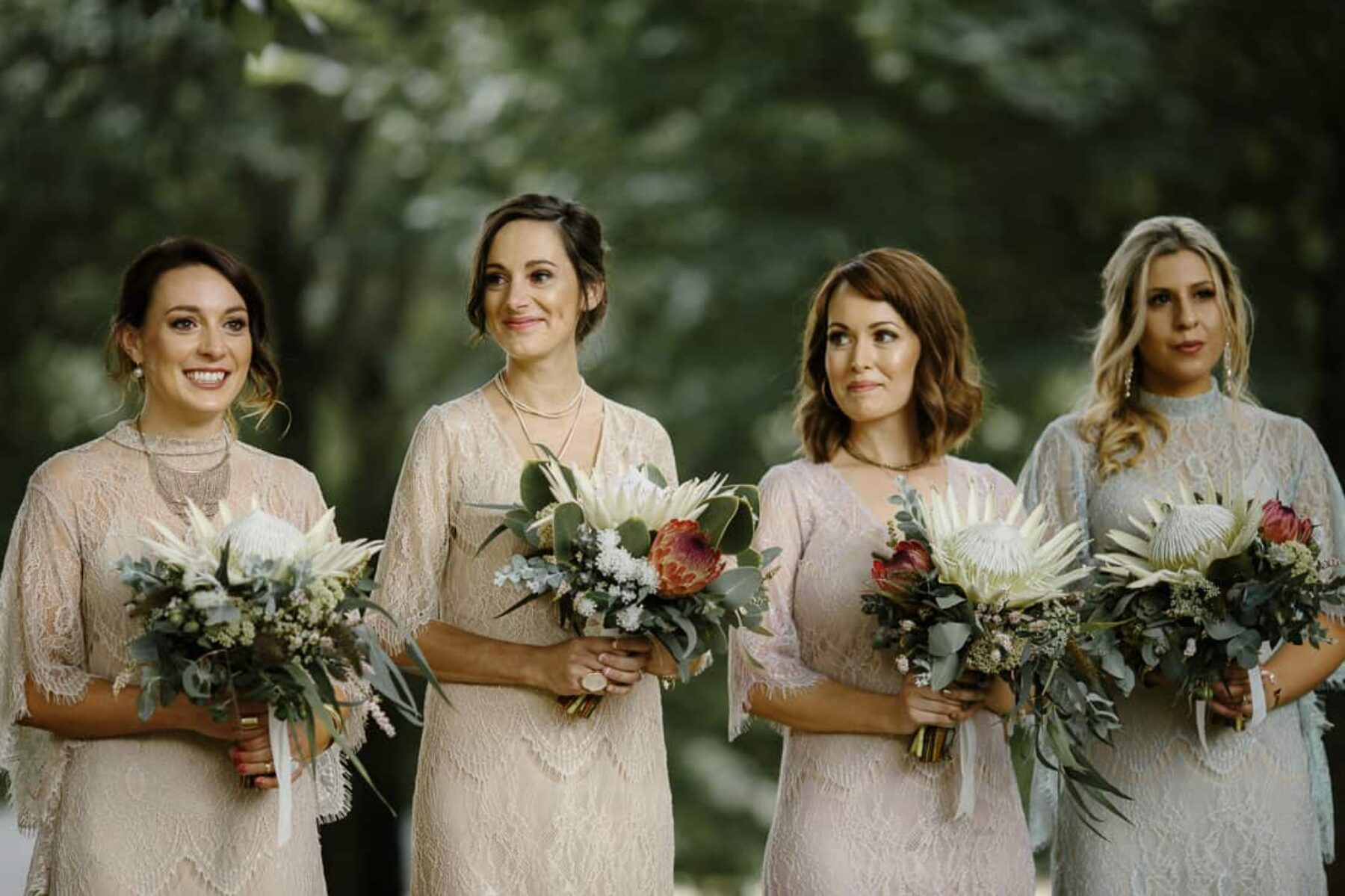 bridesmaids in mixed pastel dresses by Grace Loves Lace