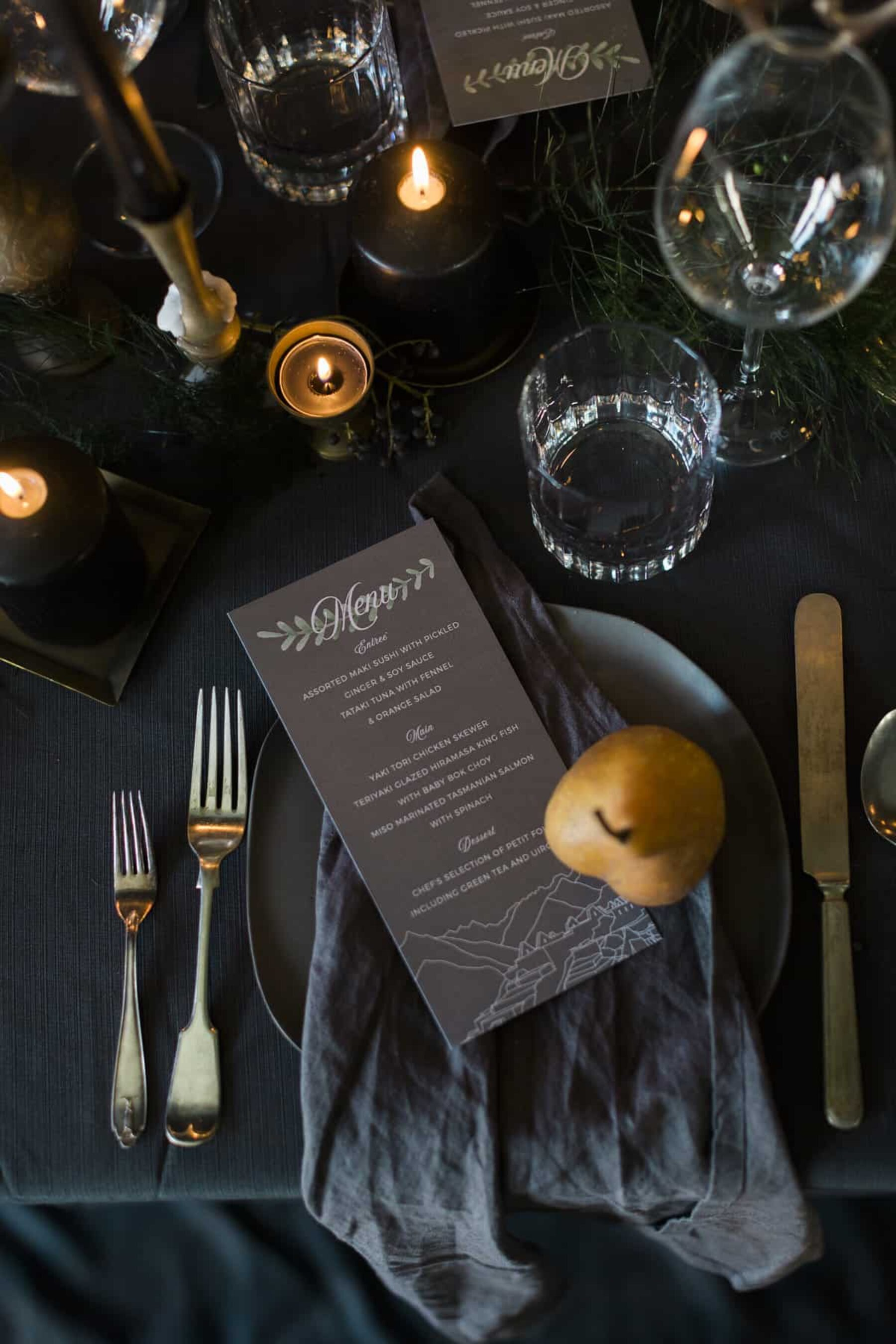 opulent tablescape with gold cutlery