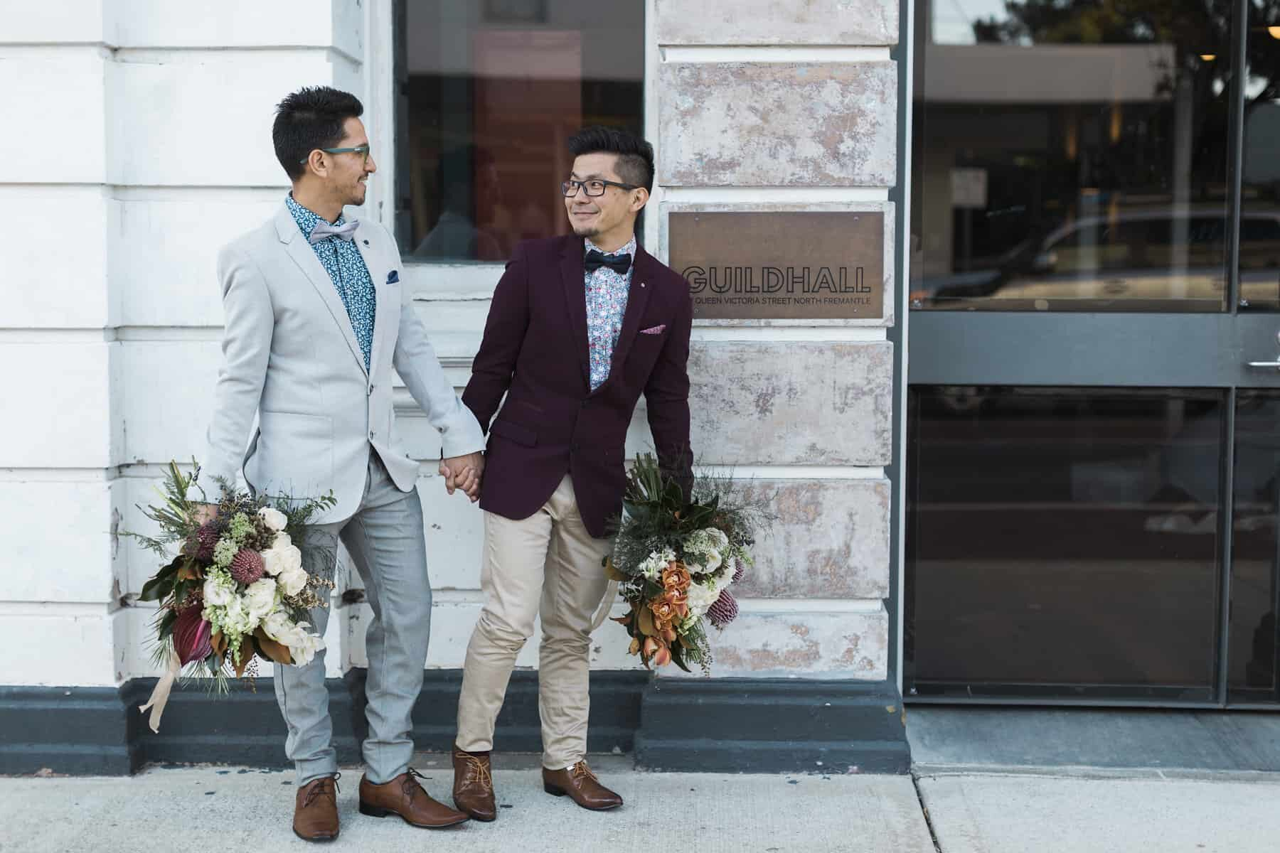 stylish grooms with blooms