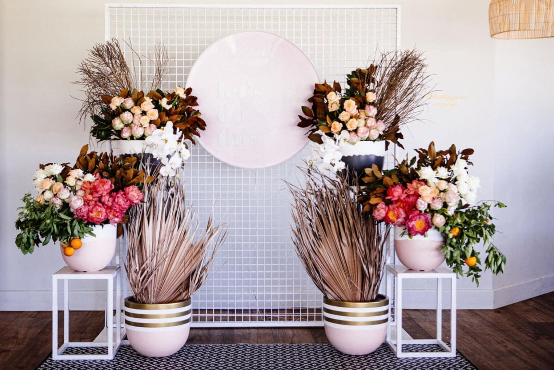 white mesh screen with floral installation