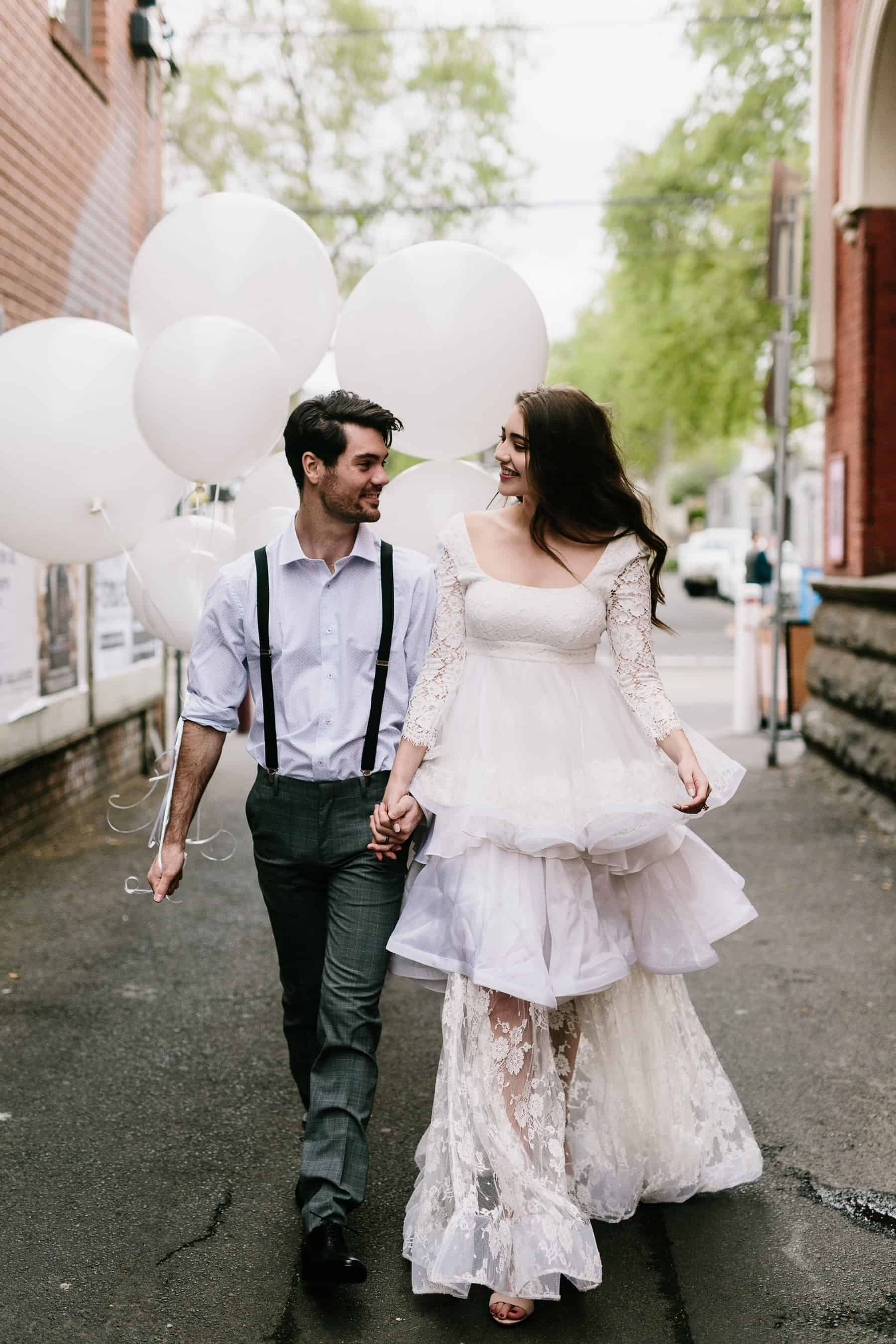 long sleeve lace weddng dress with tiered ruffle skirt