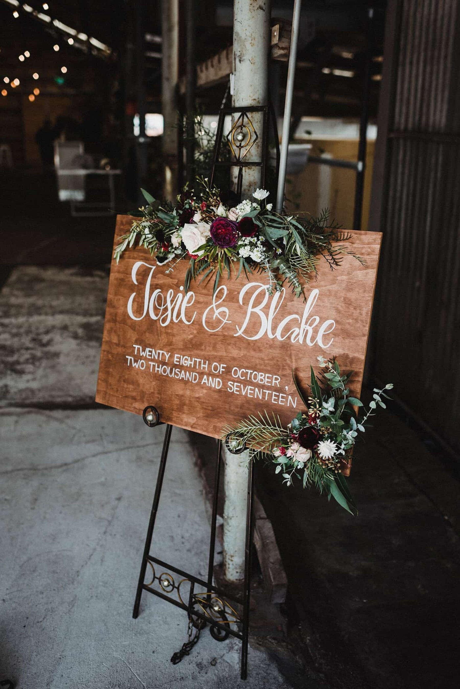 hand-lettered wooden wedding welcome sign