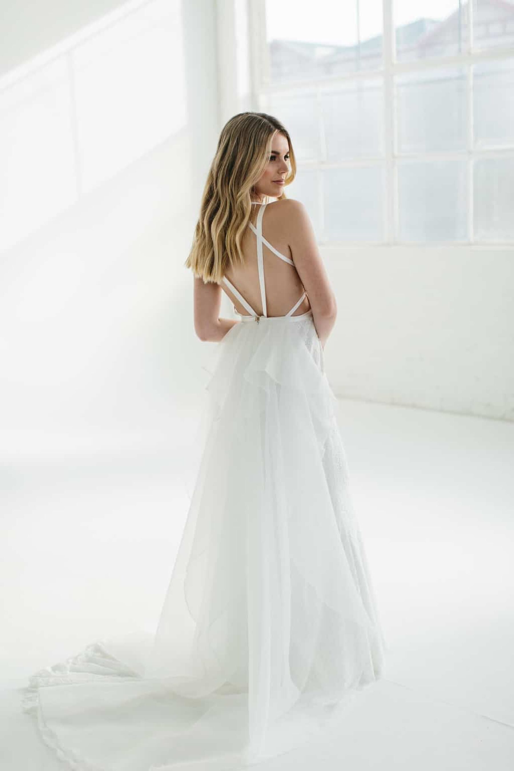 modern wedding dress with bustle and cross back detail