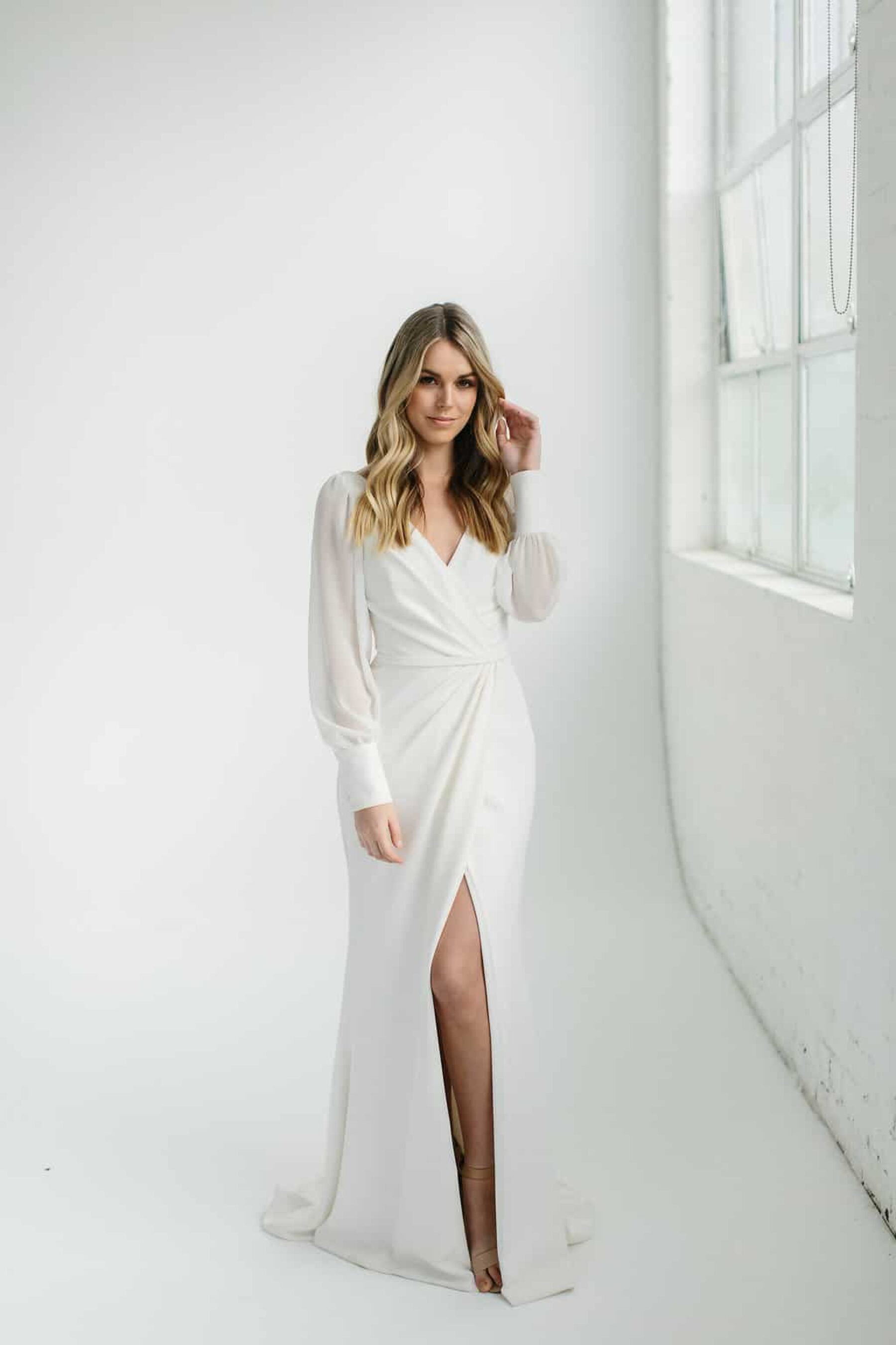 wrap style wedding dress with cuffed sleeves
