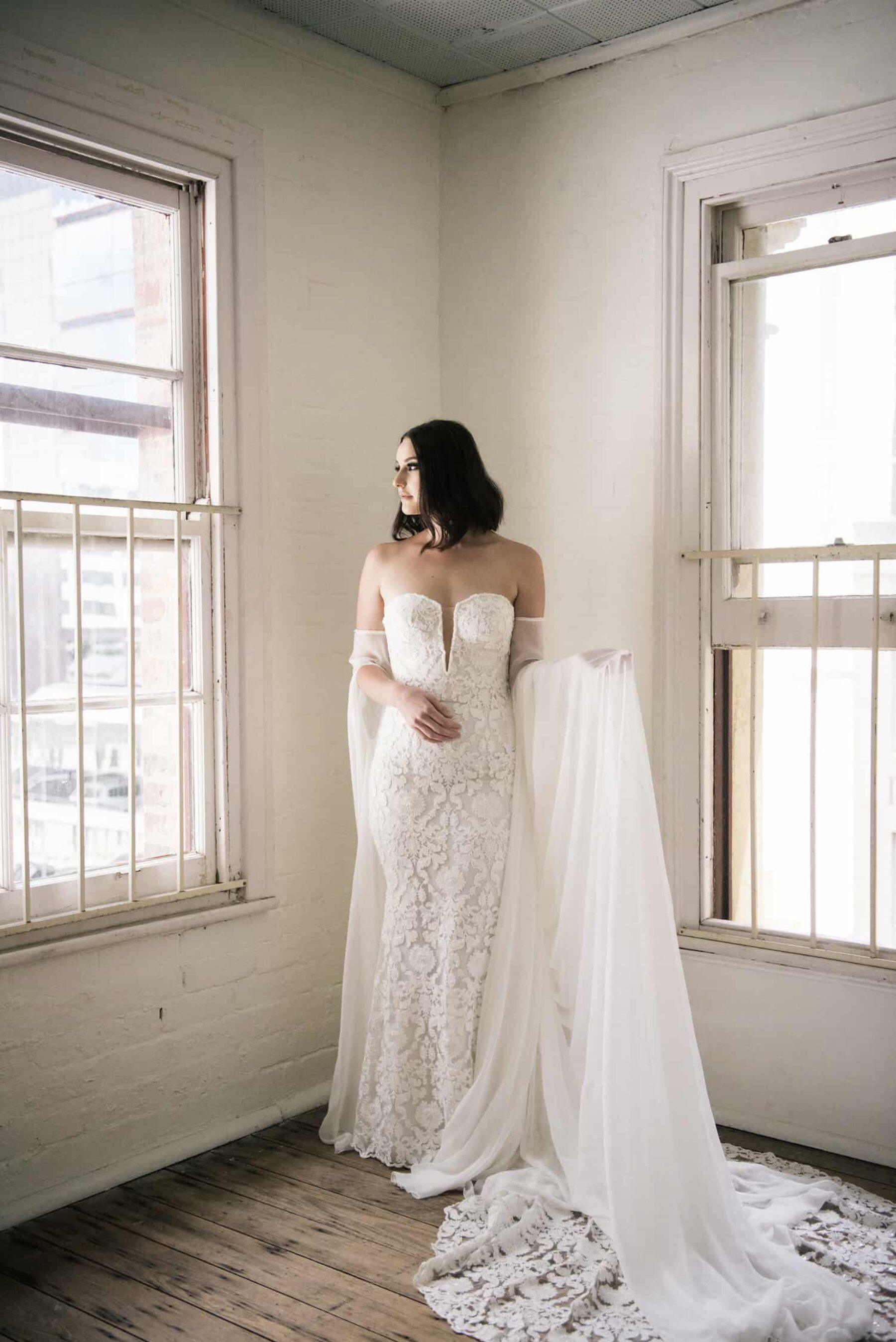strapless wedding dress with sheer cape