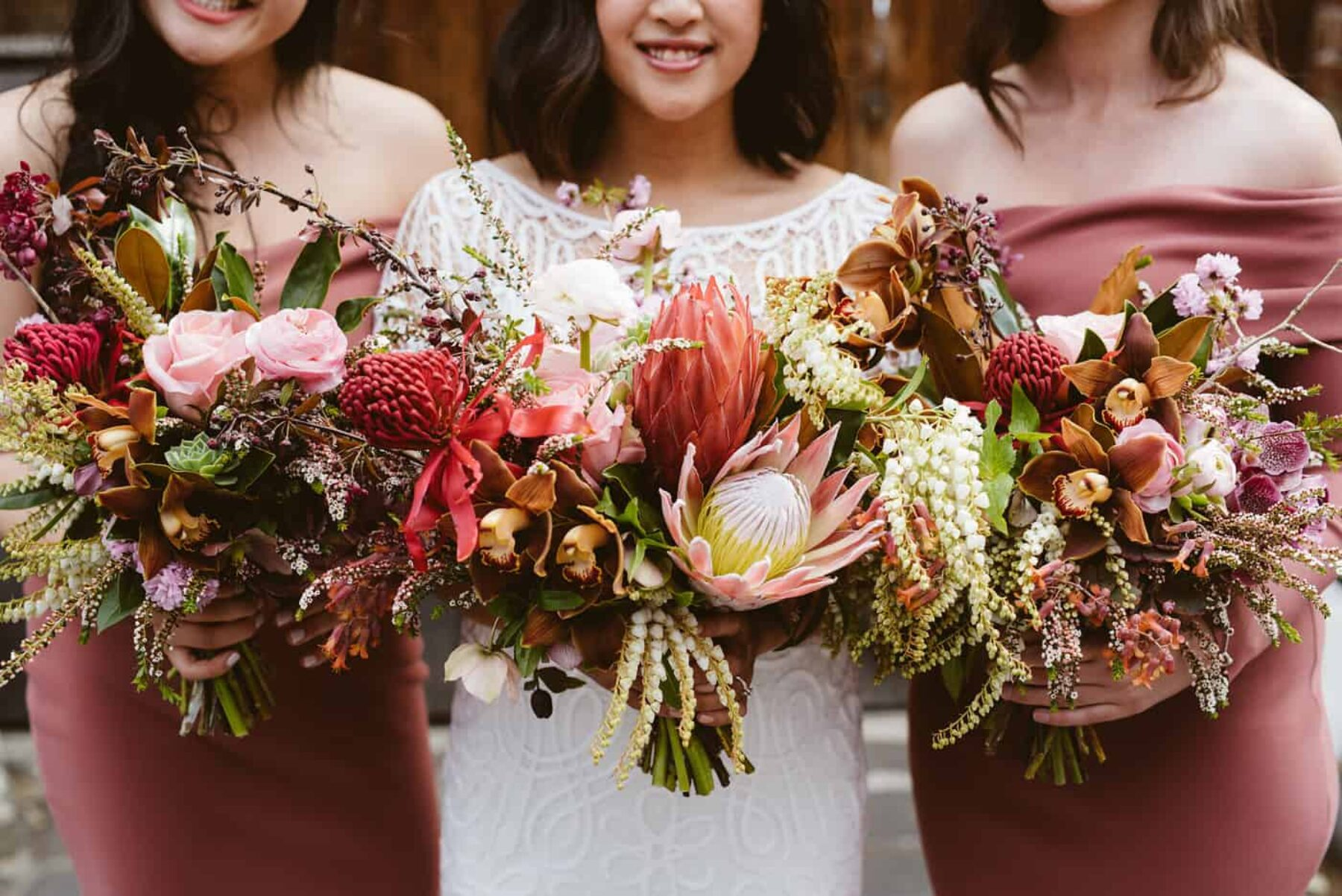 blush and dusty pink bouquets with king proteas and native flowers