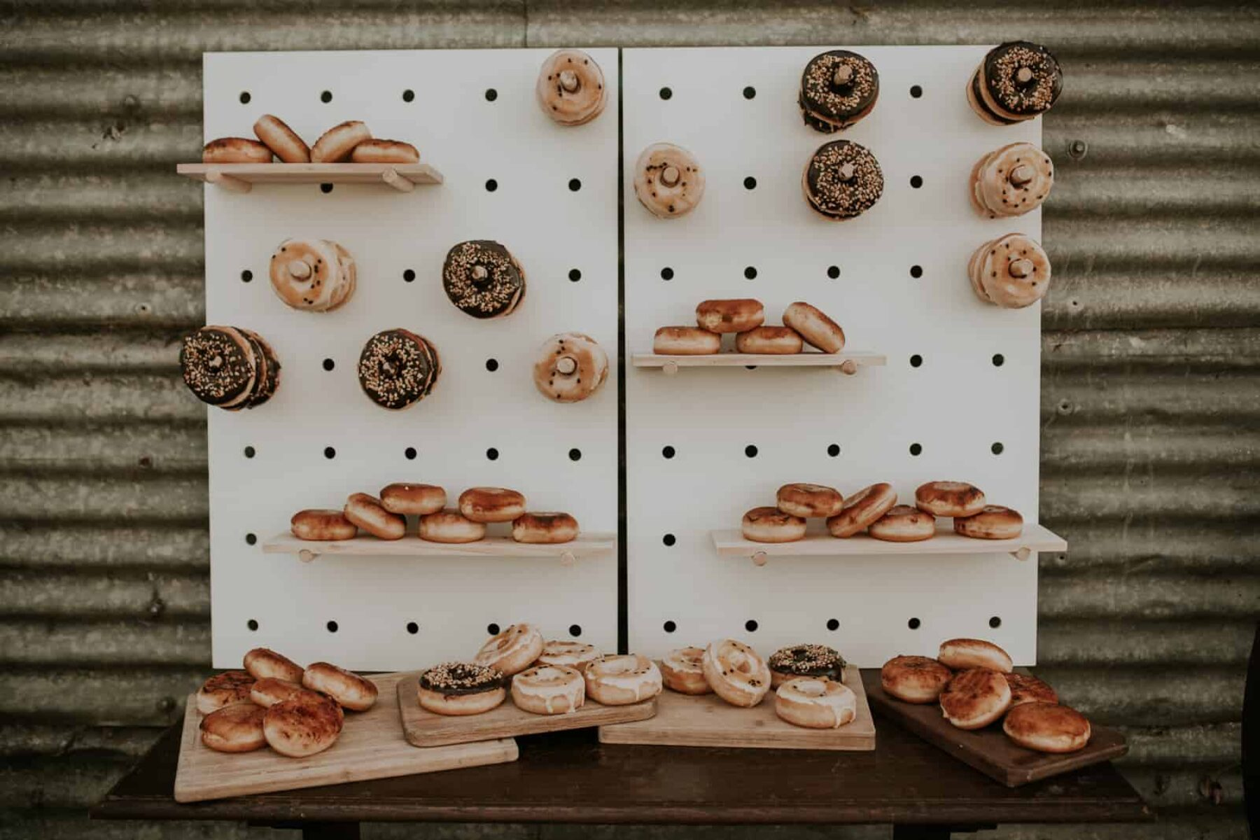 donut wall and dessert table